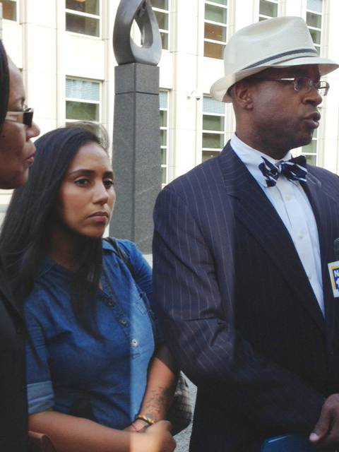 Former Metropolitan Detention Center guard, Nancy Gonzalez, center, listens as her attorney, Anthony Rico, speaks to the media in July 2013. Gonzalez gained notoriety by conceiving a baby behind bars with a cop killer.