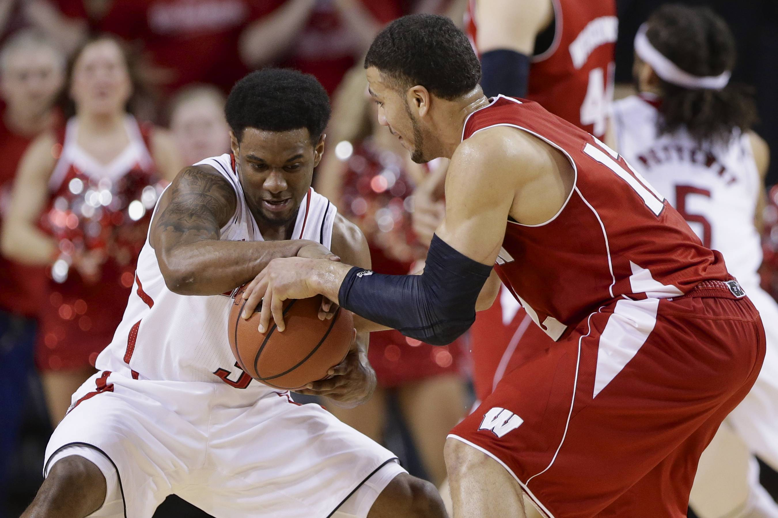 Nebraska's Benny Parker (3) grabs the ball from Wisconsin's Traevon Jackson (12) in the second half in Lincoln, Neb., Sunday.