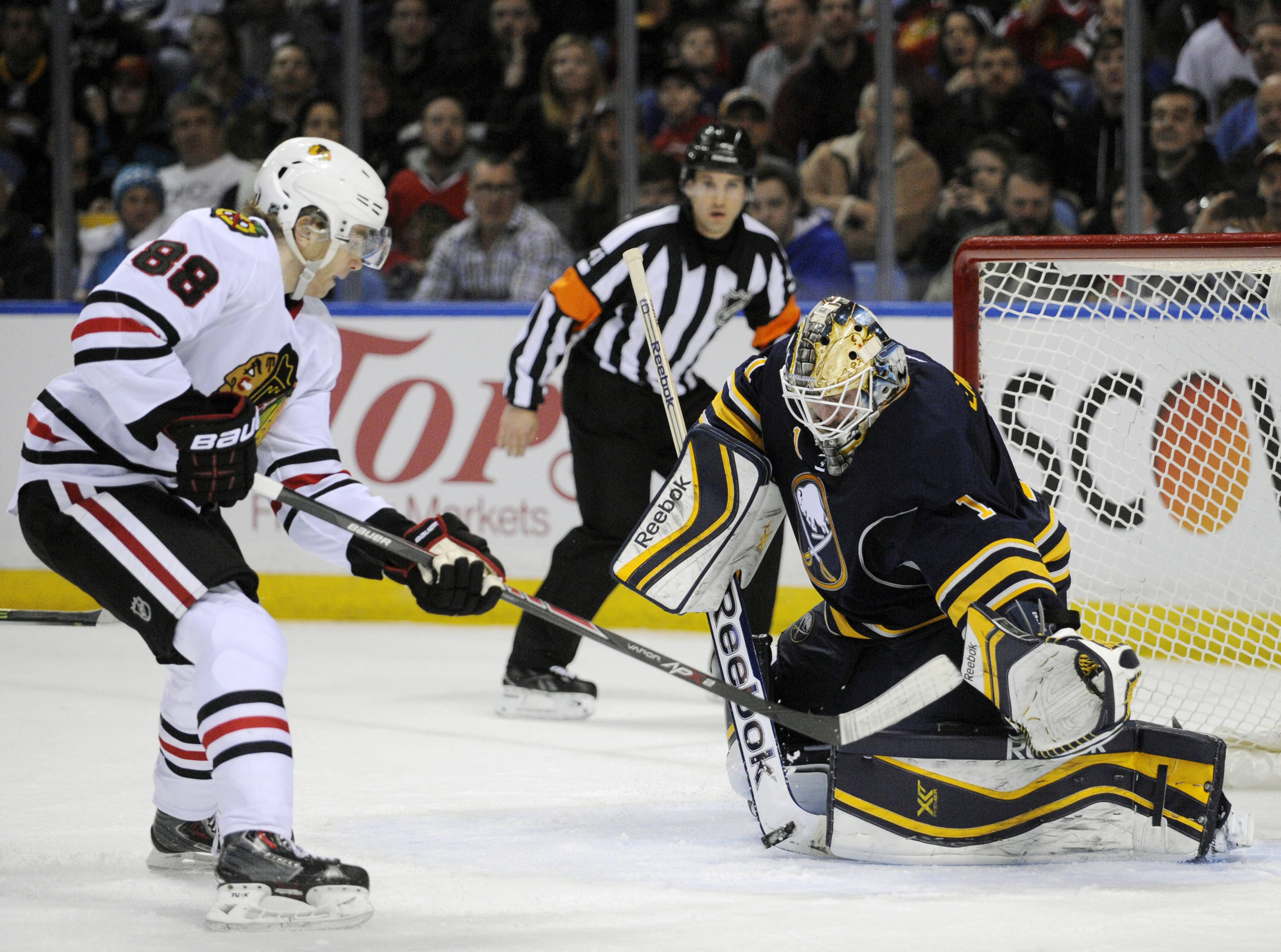 Patrick Kane gets stopped on a breakaway by Sabres goaltender Jhonas Enroth, but it was Kane who opened the scoring early in the first period Sunday night.