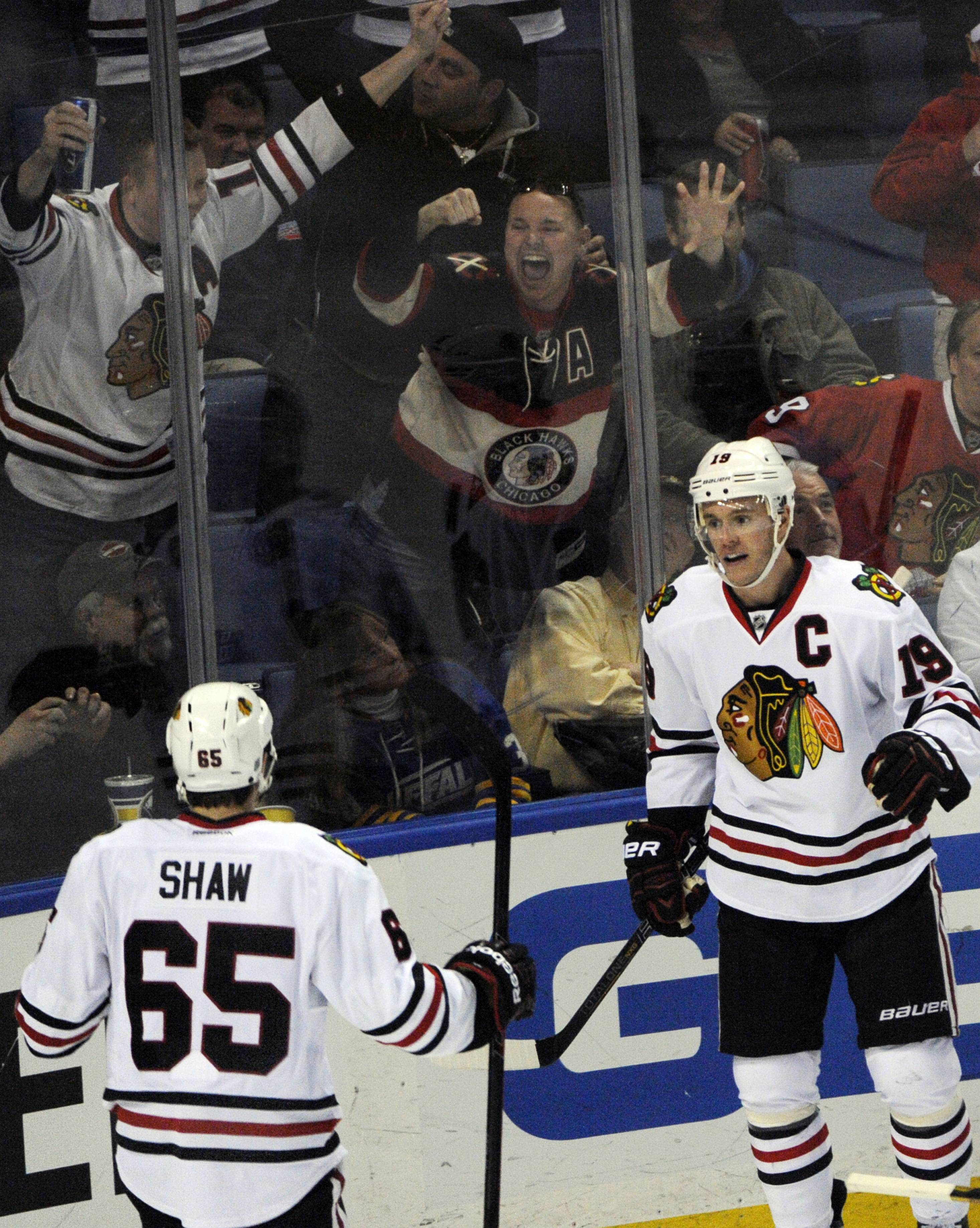 Chicago Black Hawks center Andrew Shaw (65) celebrates with center Jonathan Toews (19) after Toews scored the game-winning goal during the third period against the Buffalo Sabres in Buffalo, N.Y., Sunday.