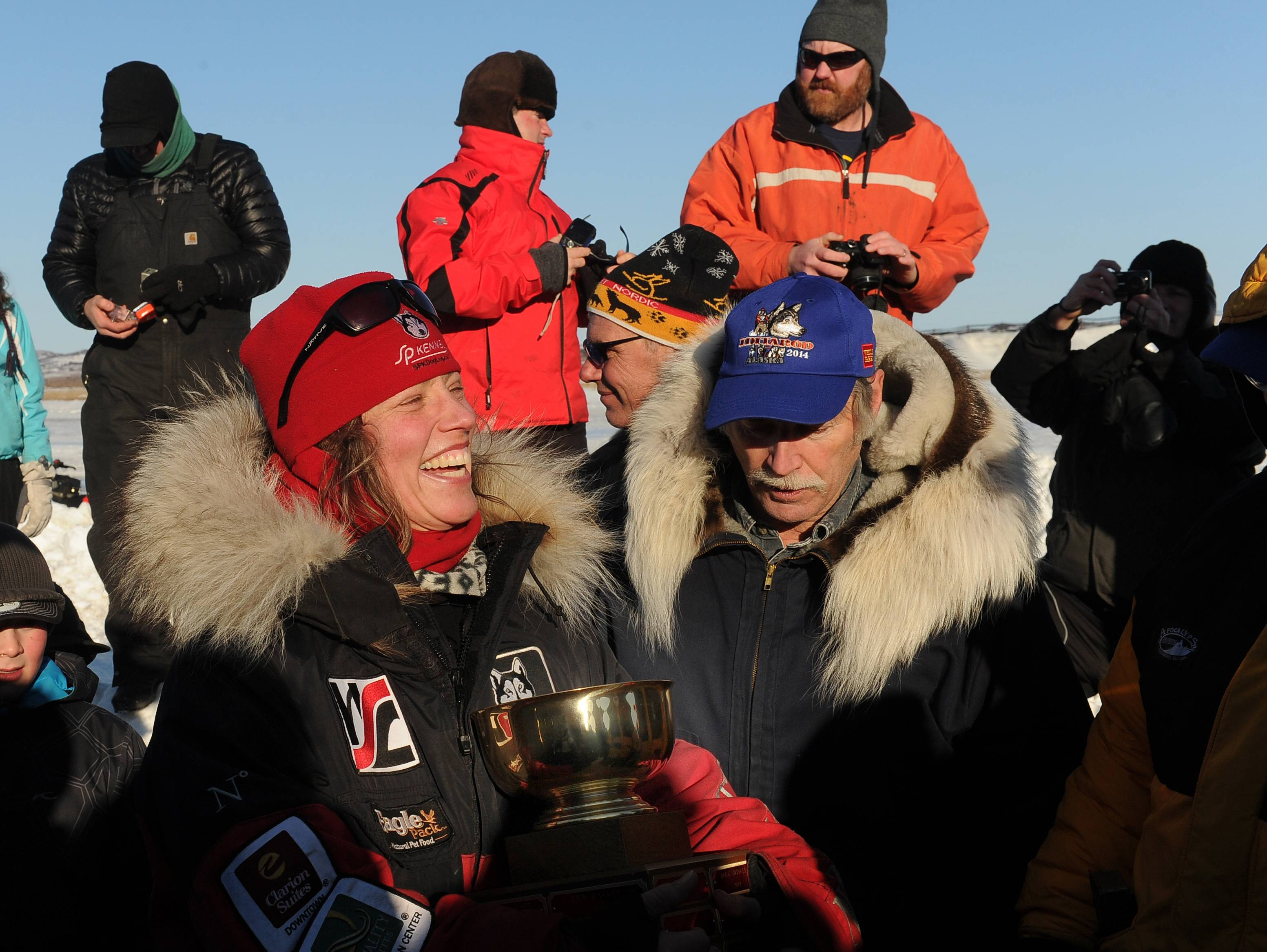 Aliy Zirkle accepts the Wells Fargo Gold Coast Award for the first musher to reach the Bering Sea in Unalakleet during the 2014 Iditarod Trail Sled Dog Race.