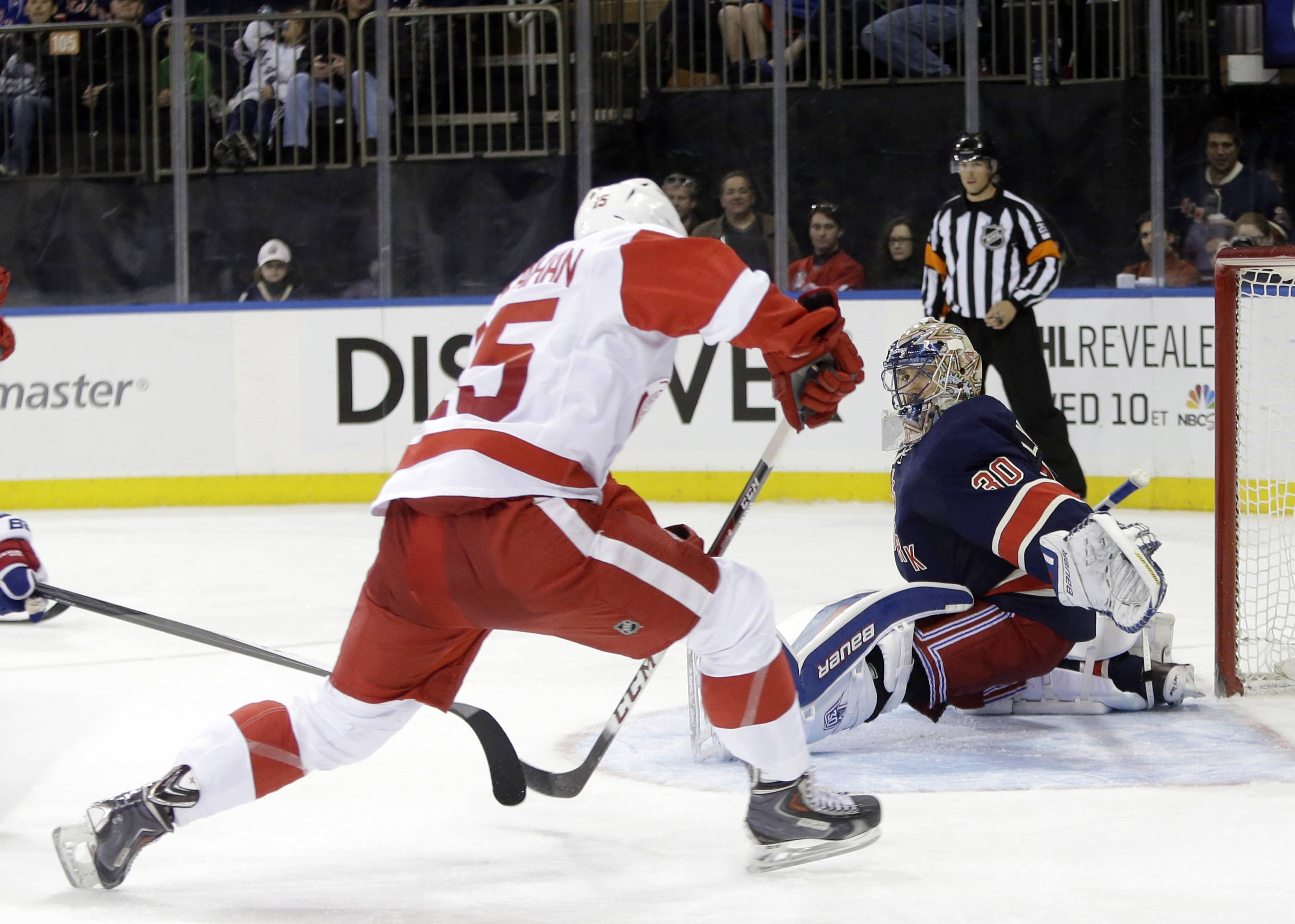 New York Rangers goalie Henrik Lundqvist (30), of Sweden, dives to stop a shot by Detroit Red Wings' Riley Sheahan (15) during the third period Sunday in New York. The Rangers won the game 3-0.