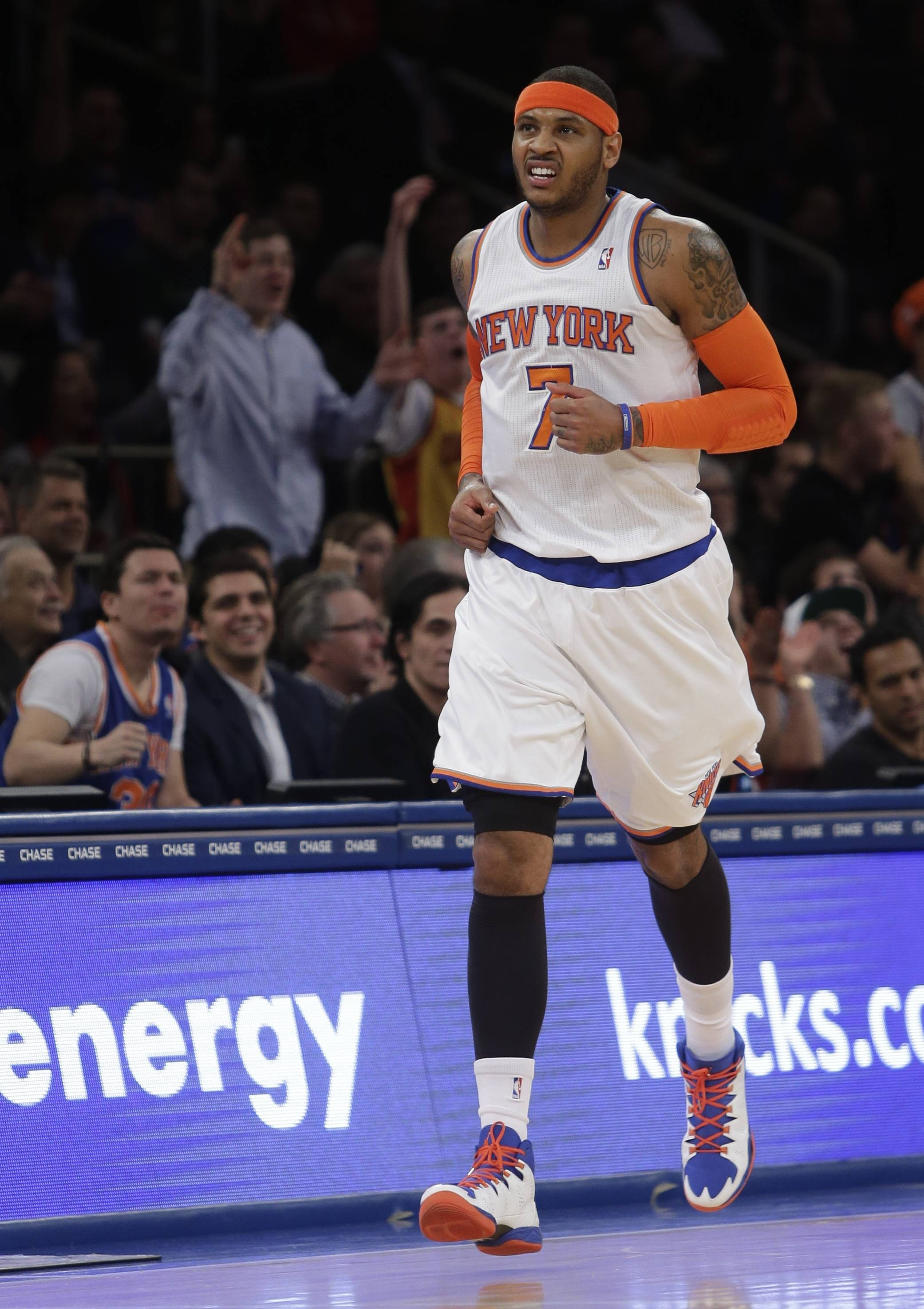 The Knicks' Carmelo Anthony reacts after scoring during the first half against the Utah Jazz on Friday night.