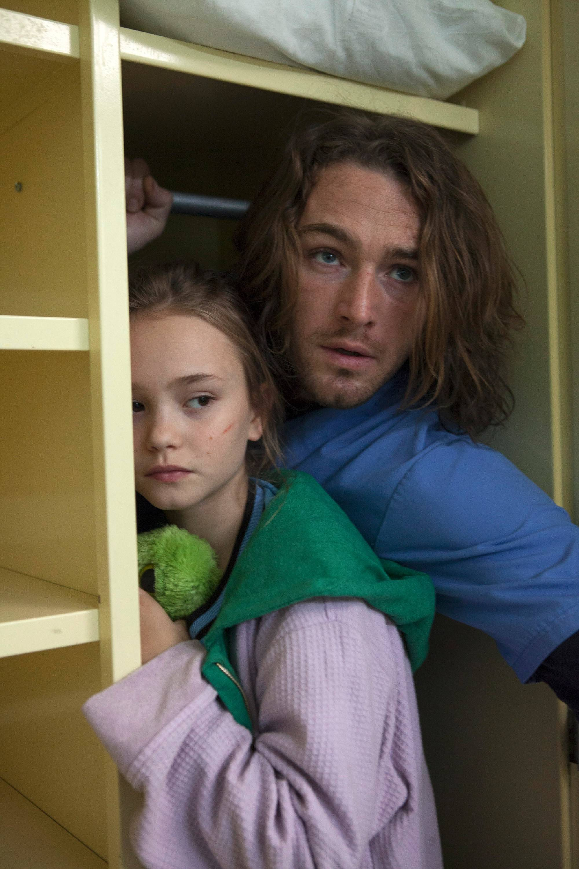 "Tate (Jake McLaughlin) tries to protect Bo (Johnny Sequoyah), who harbors special powers she can't completely control, in NBC's new drama ""Believe."""