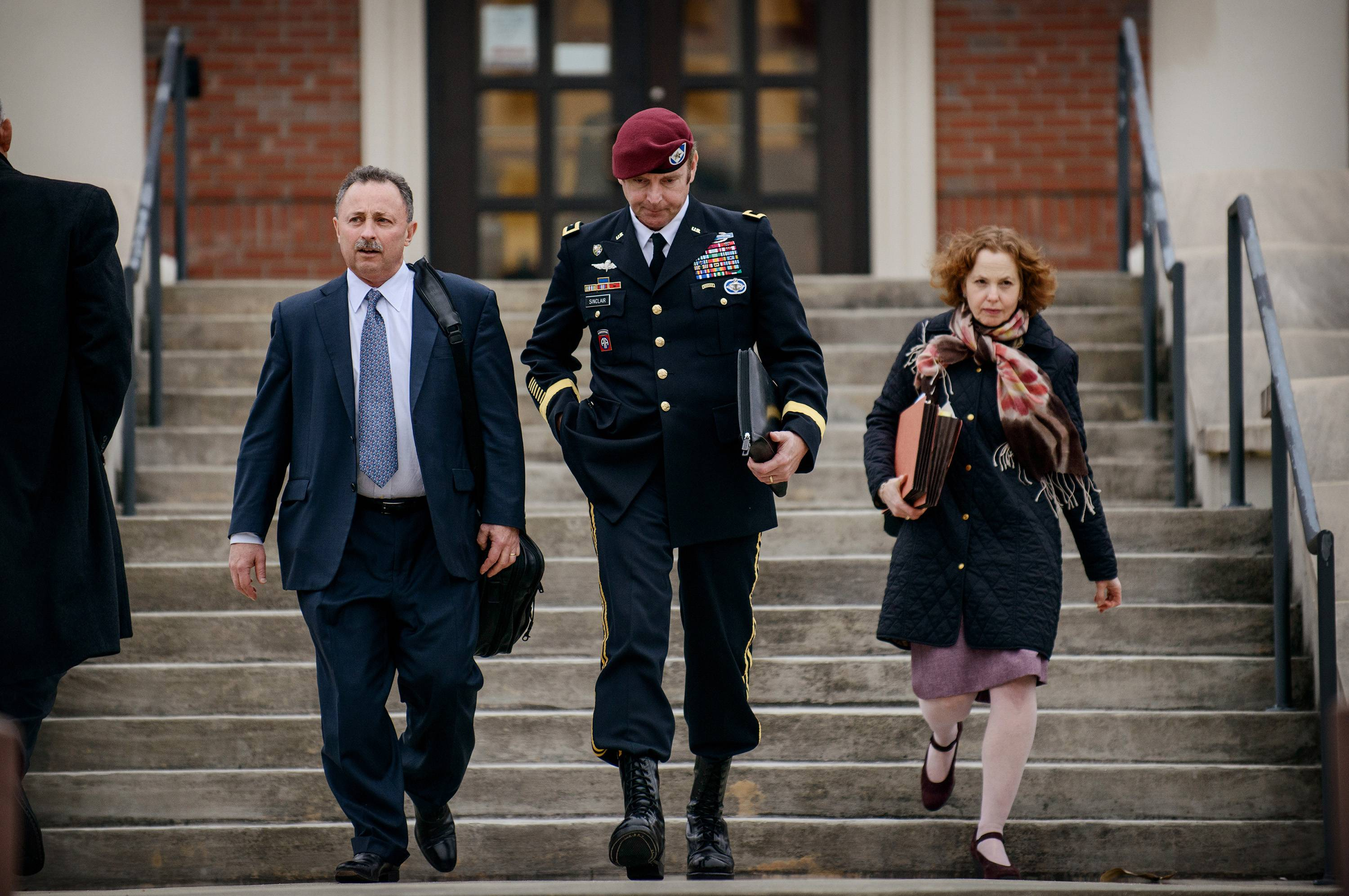 Brig. Gen. Jeffrey Sinclair leaves the courthouse with his lawyers Richard Scheff, left, and Ellen C. Brotman, following a day of motions at Fort Bragg, N.C., March 4. A military judge declined Monday to dismiss sexual assault charges against Sinclair.