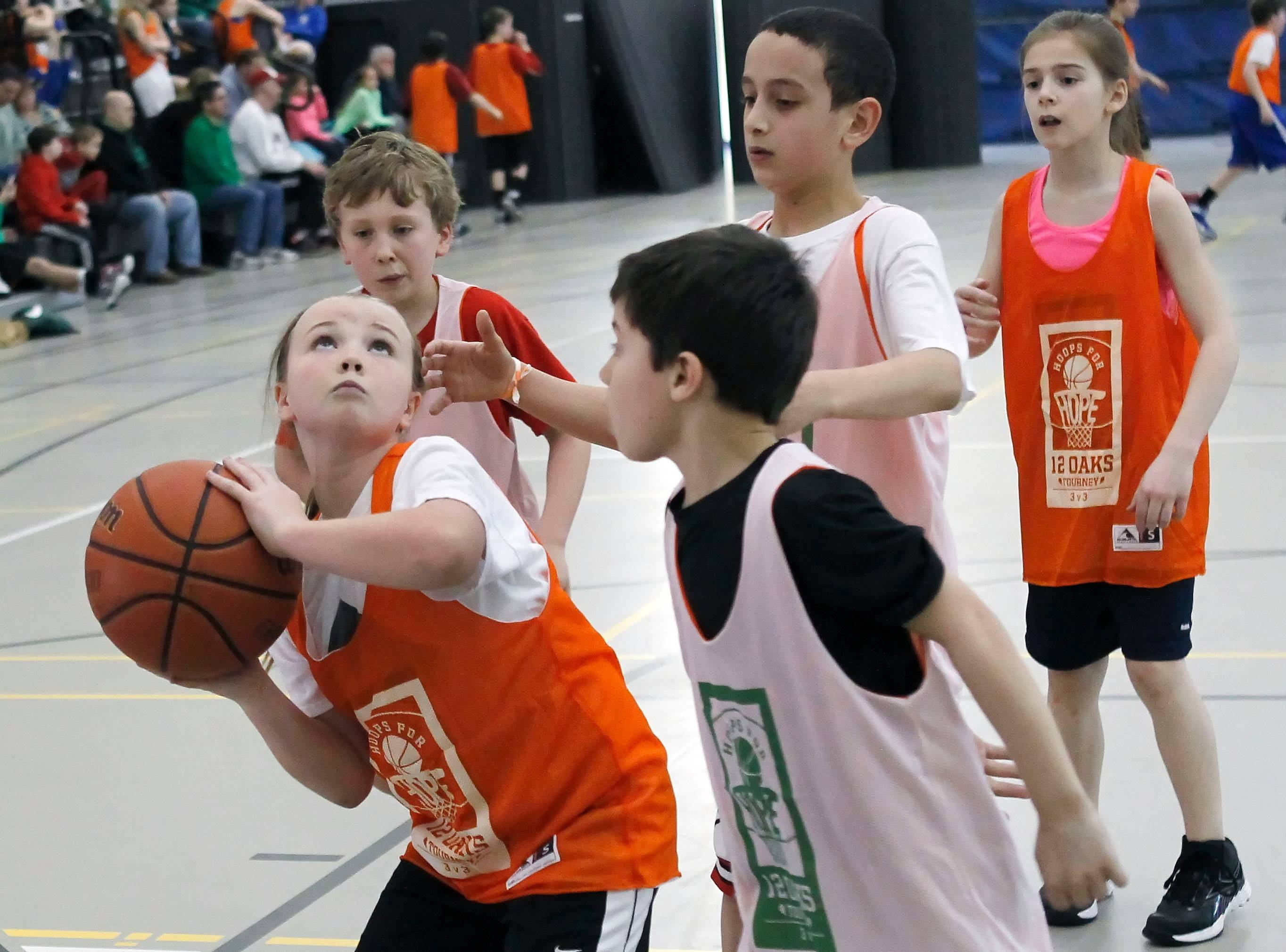 "Shannon Brennan of Grayslake prepares to take a shot in the 12 Oaks Foundation's ""Hoops for Hope"" 3-on-3 basketball tournament. This year's tournament will take place Saturday and Sunday, March 15 and 16, at Grayslake North High School."