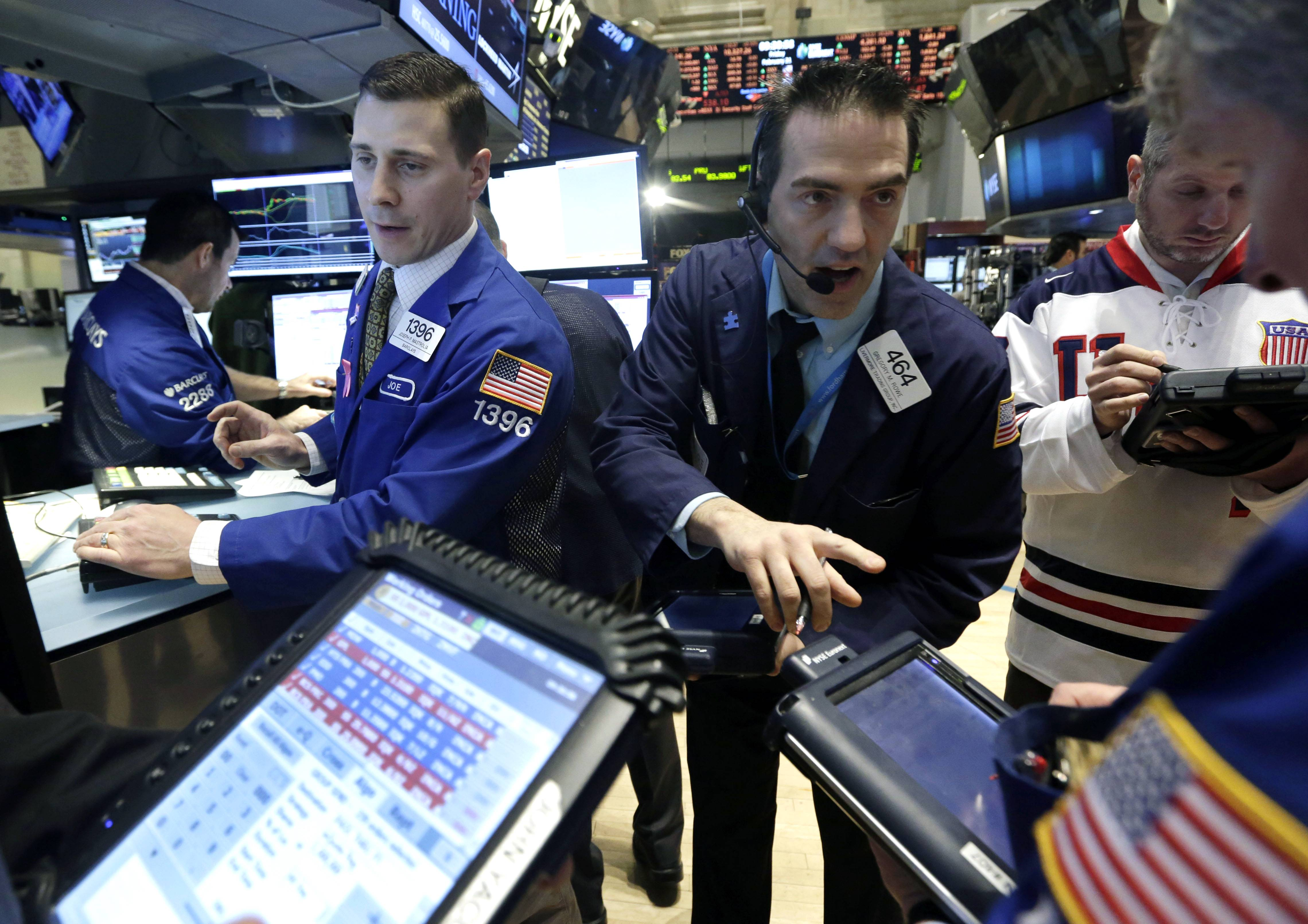 Stocks slid Monday, pulling the Standard & Poor's 500 Index down from a record, as a slowdown in Chinese exports fueled concern about global economic growth.