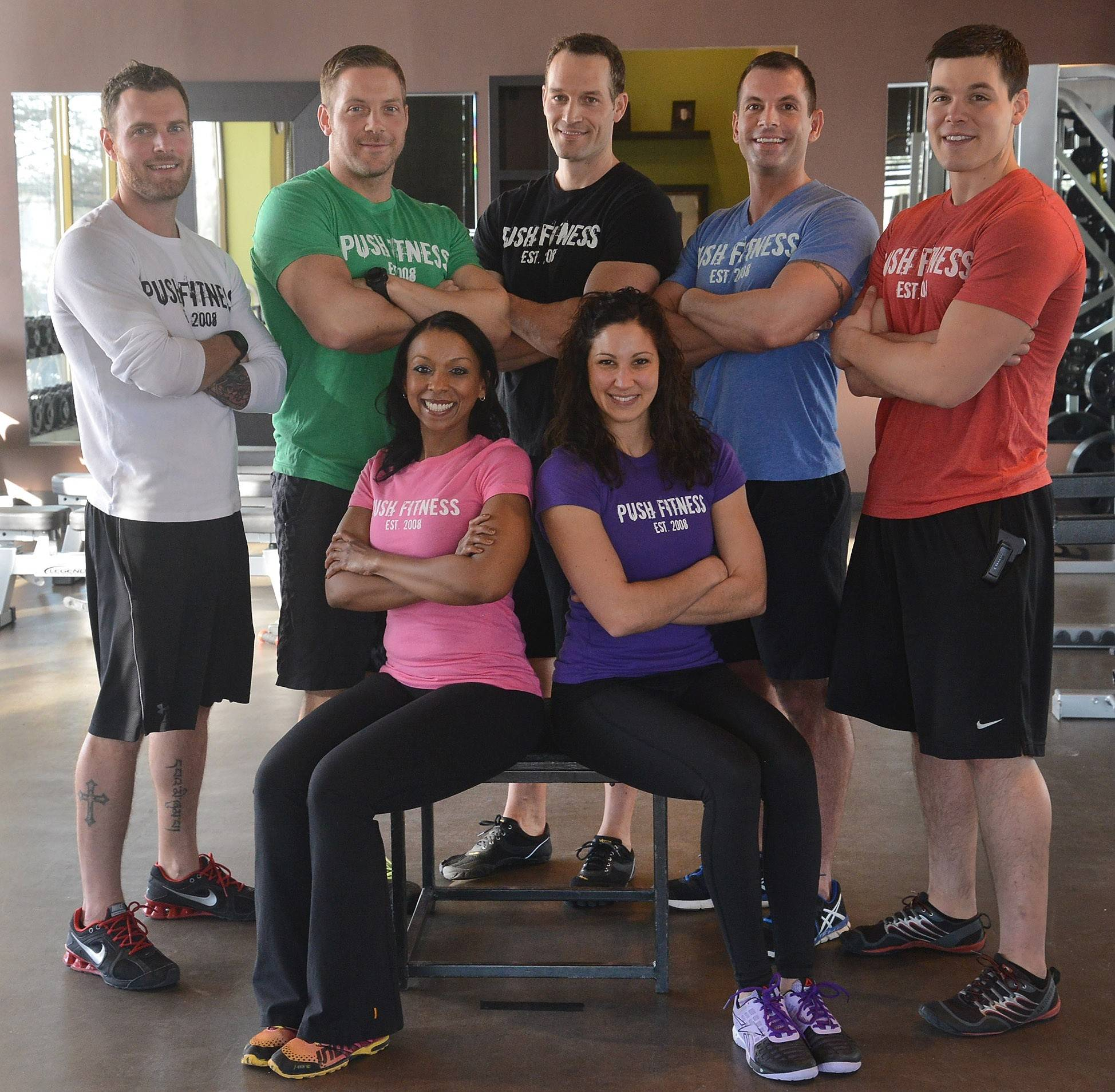 These seven trainers are the driving force behind the 2014 Fittest Loser contestants. Seated, Michelle Amsden, left, and Lindsay Vigna. Standing, from left, Brad Parotto, Brodie Medlock, Joshua Steckler, Steve Amsden and Wade Merrill.