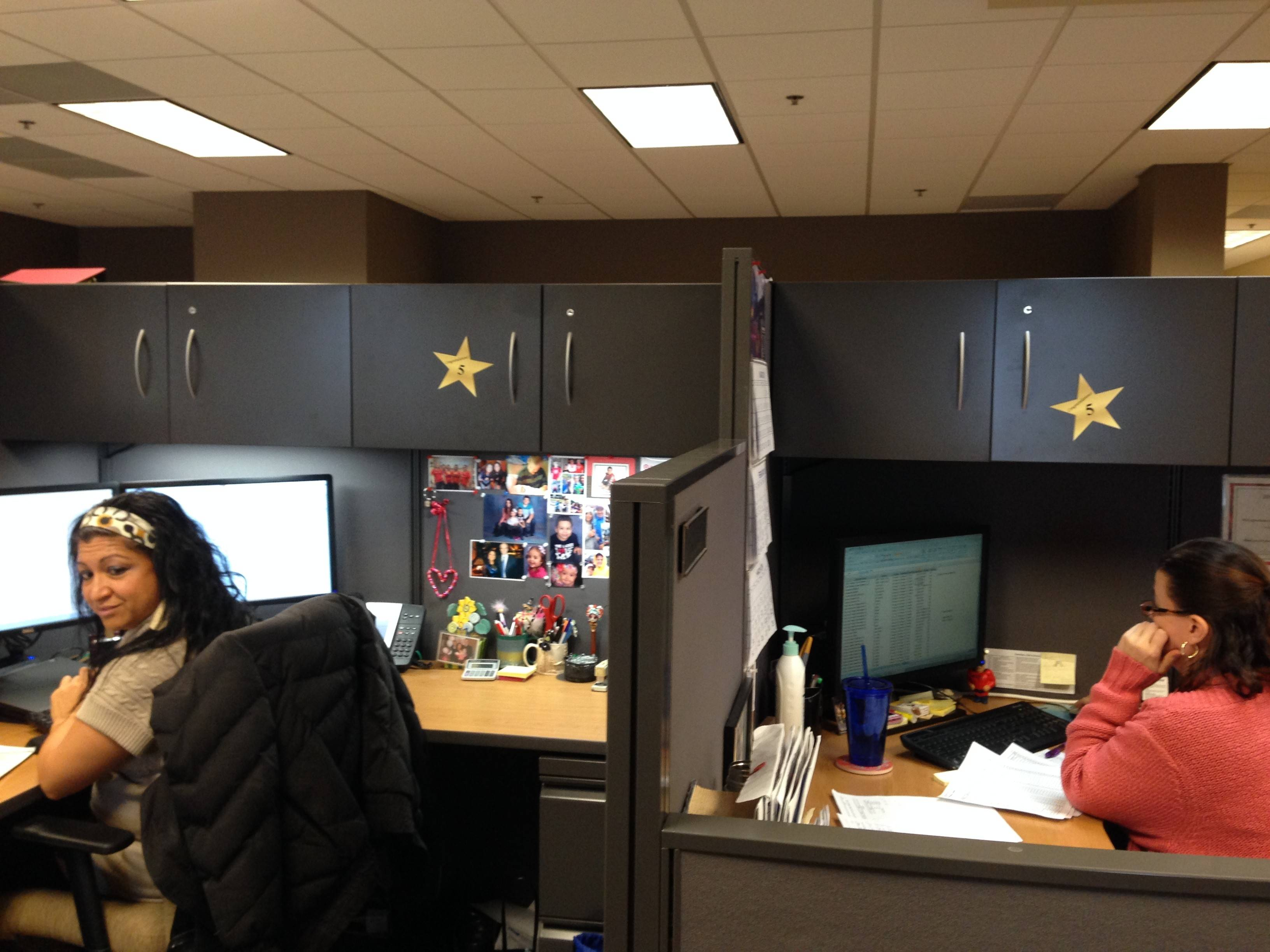 "Prinova ""Whey to Go"" team members show off the gold stars they received for their 5-pound weight loss."