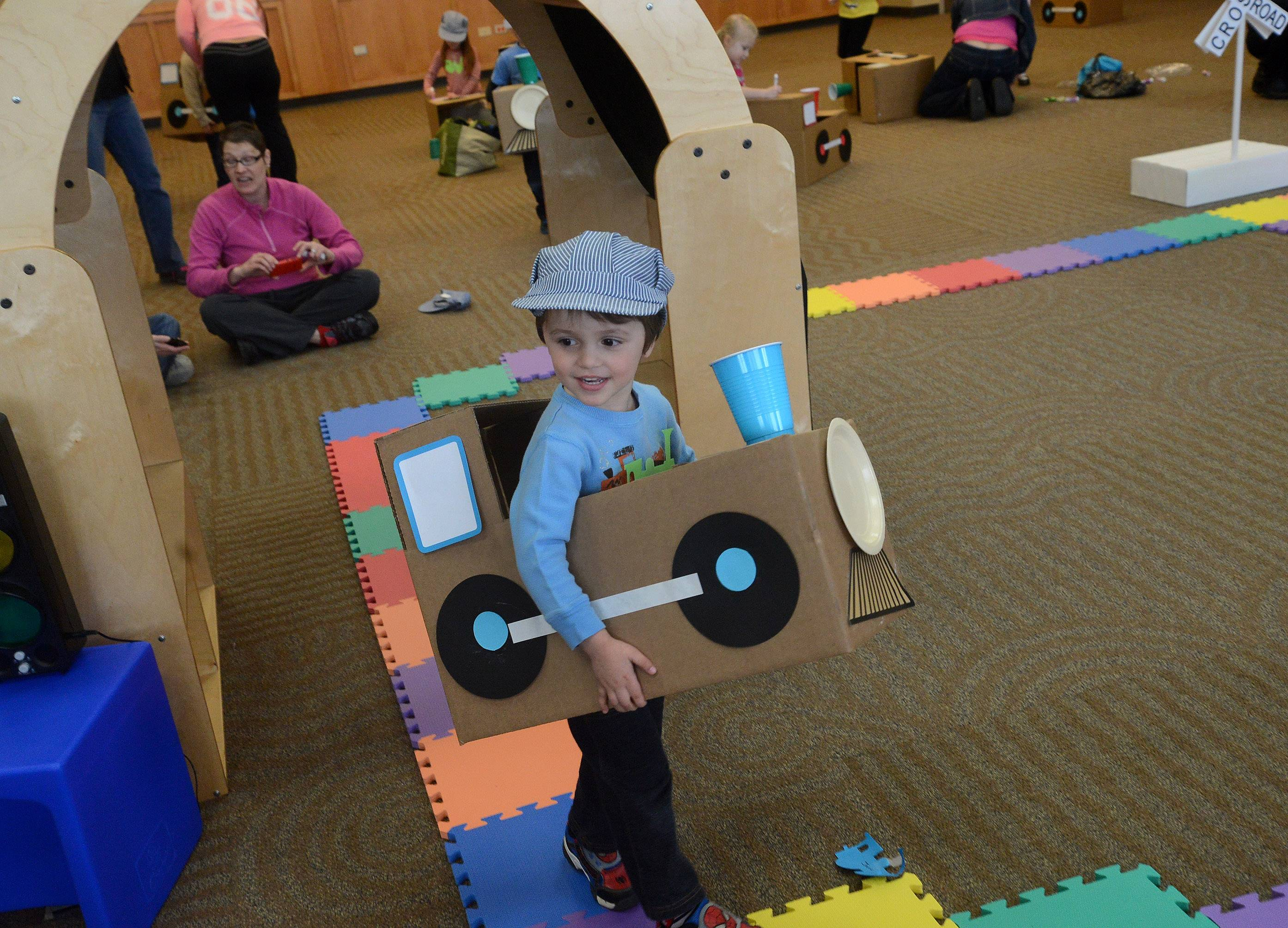 "Ryan Jenkins makes his way around the track Tuesday during the ""Wild About Trains"" program at the Ela Area Public Library in Lake Zurich."