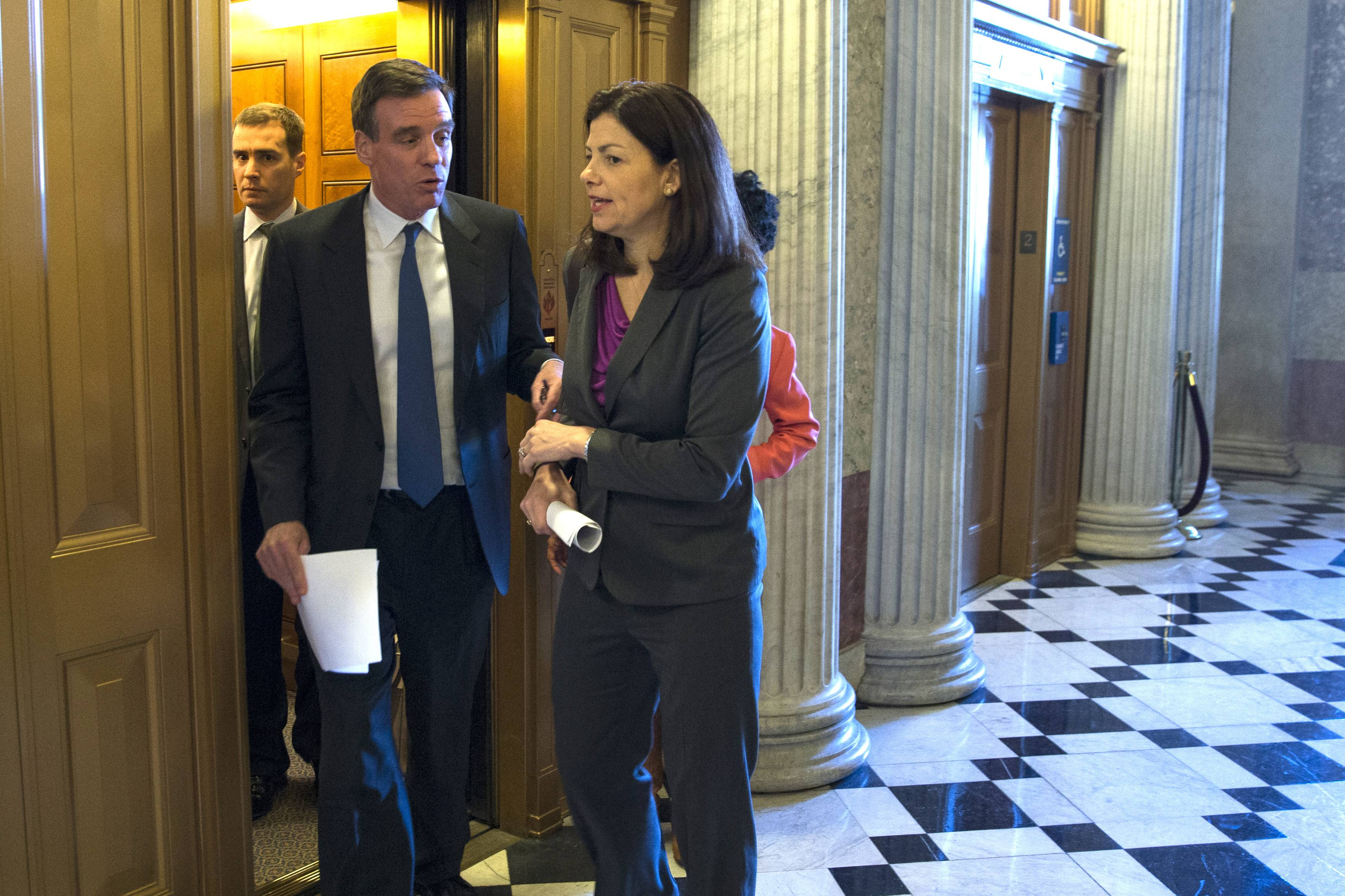 Sen. Kelly Ayotte, a New Hampshire Republican, right, and Sen. Mark Warner, a Virginia Democrat, arrive for a Senate vote on military sexual assault legislation on Capitol Hill Monday.