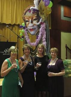 A pre-party toast to success, from left, Rosemary Justen, Nancy Redmond, Trustee Gayle Vandenbergh and Bonnie McCulla.