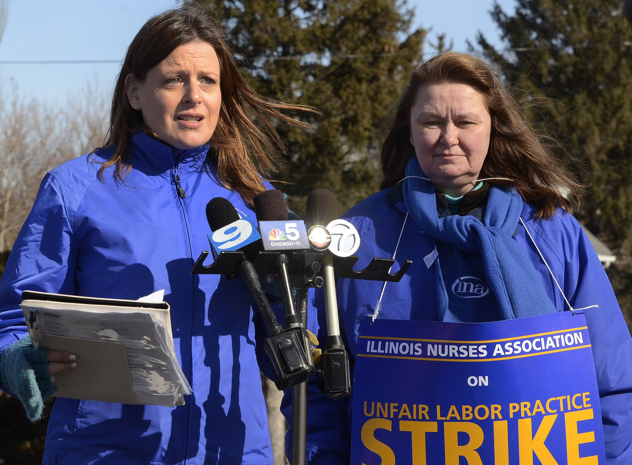 Alice J. Johnson, left, executive director of the Illinois Nurses Association, and nurse Candi Vanzandt discuss the union's grievances Monday against Maryville Behavioral Health Hospital in Des Plaines.