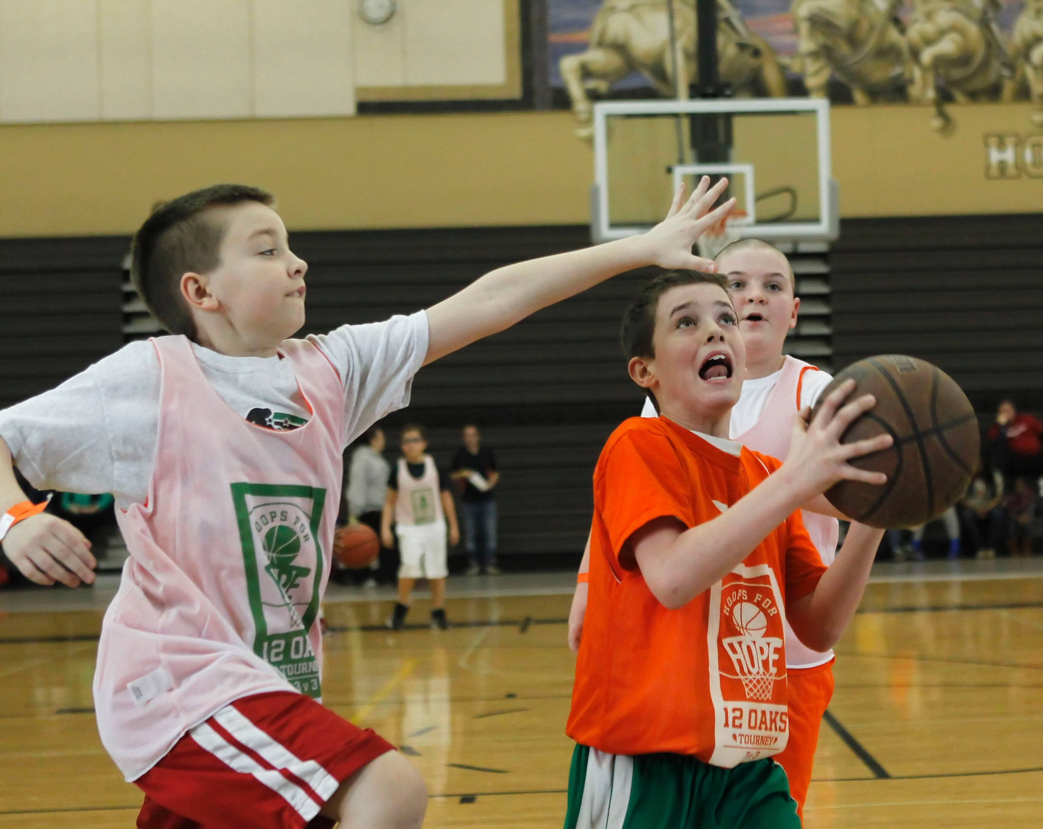 "Nick Fish of Grayslake lines up a shot in the 12 Oaks Foundation's ""Hoops for Hope"" 3-on-3 basketball tournament."