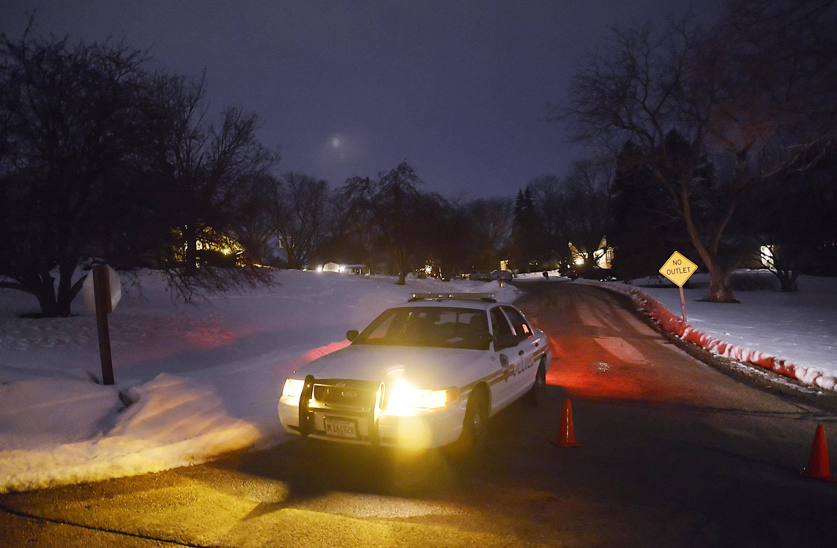 Sleepy Hollow police block in the intersection of Hemlock Dr. at Maple Ln. as they investigate a fatal police shooting at the end of the Maple Ln. cul-de-sac Sunday evening.