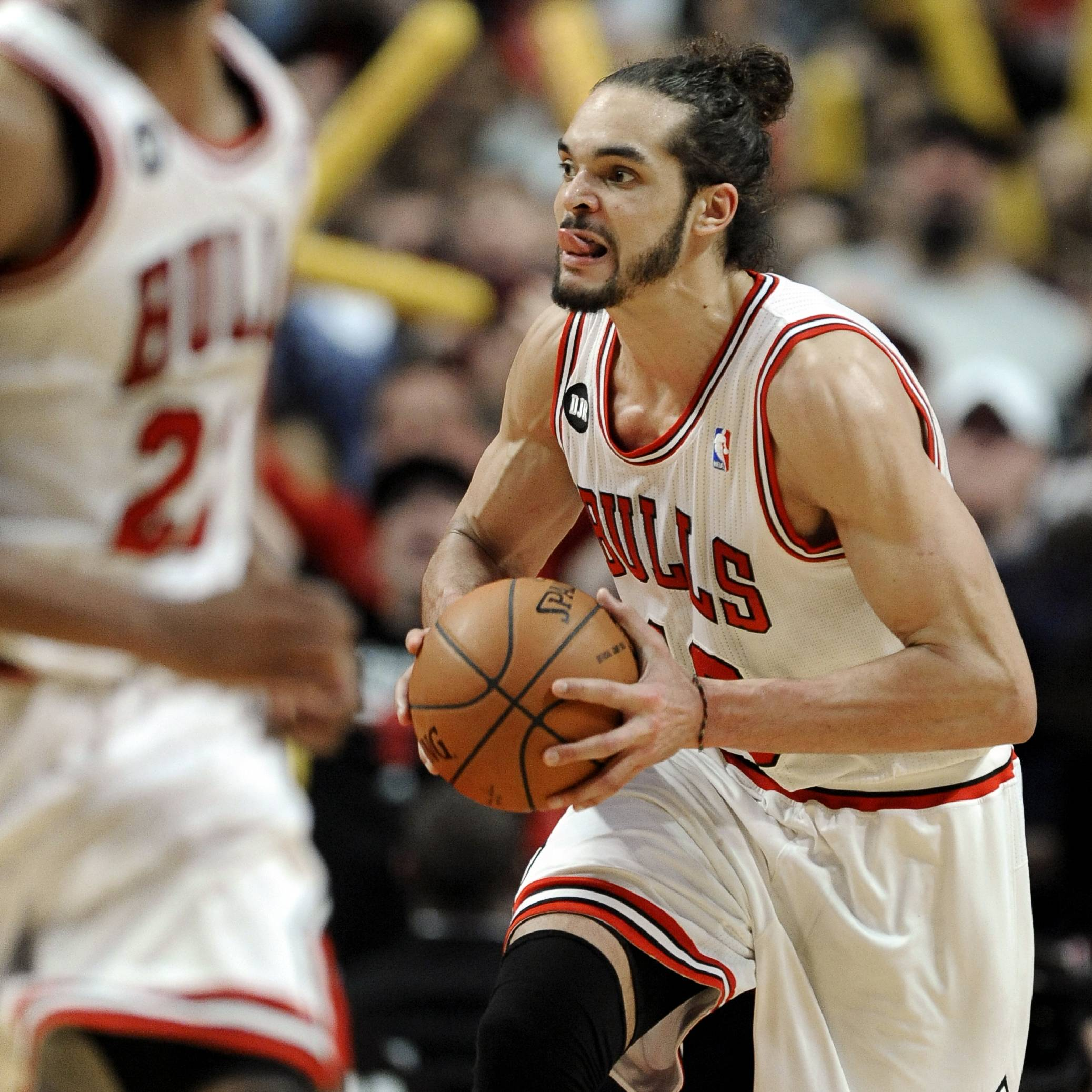 Bulls forward Joakim Noah, right, looks to pass after grabbing a rebound during overtime Sunday against the Miami Heat in Chicago. The Bulls won 95-88 in overtime.