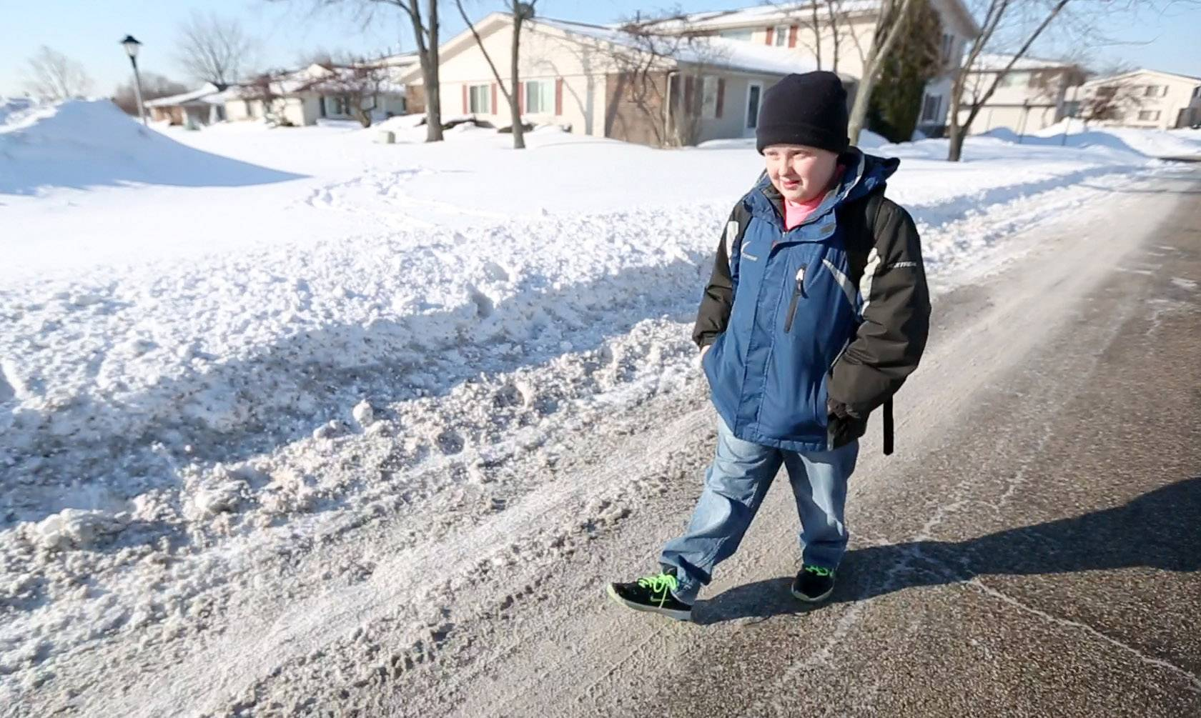 Matthew Sim, 12, has been walking to Enders-Salk Elementary School on Barcliffe Lane because sidewalks are impassable in his Schaumburg neighborhood.