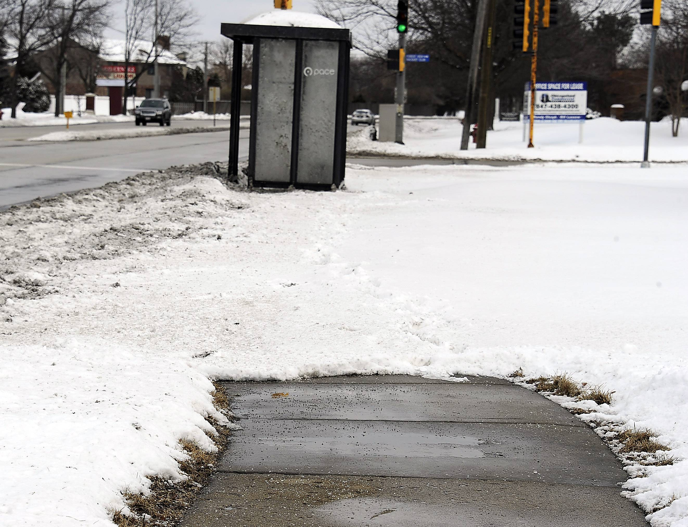 The snow removal only goes so far on this sidewalk leading up to the Pace bus stop along Golf Road in Arlington Heights.