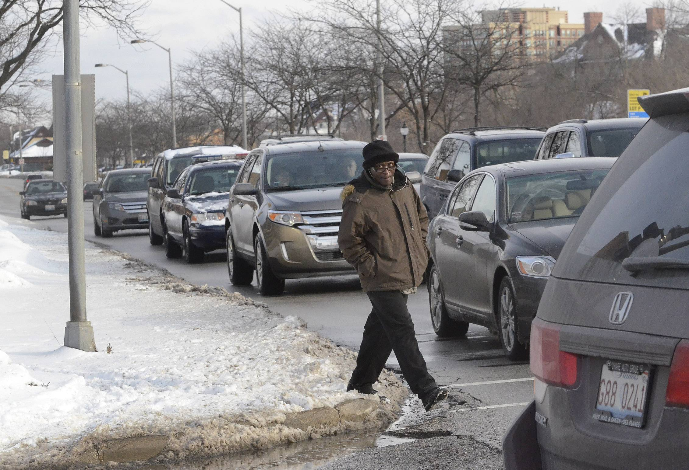 A pedestrian navigates the snowy sidewalks last week along Northwest Highway in Arlington Heights.