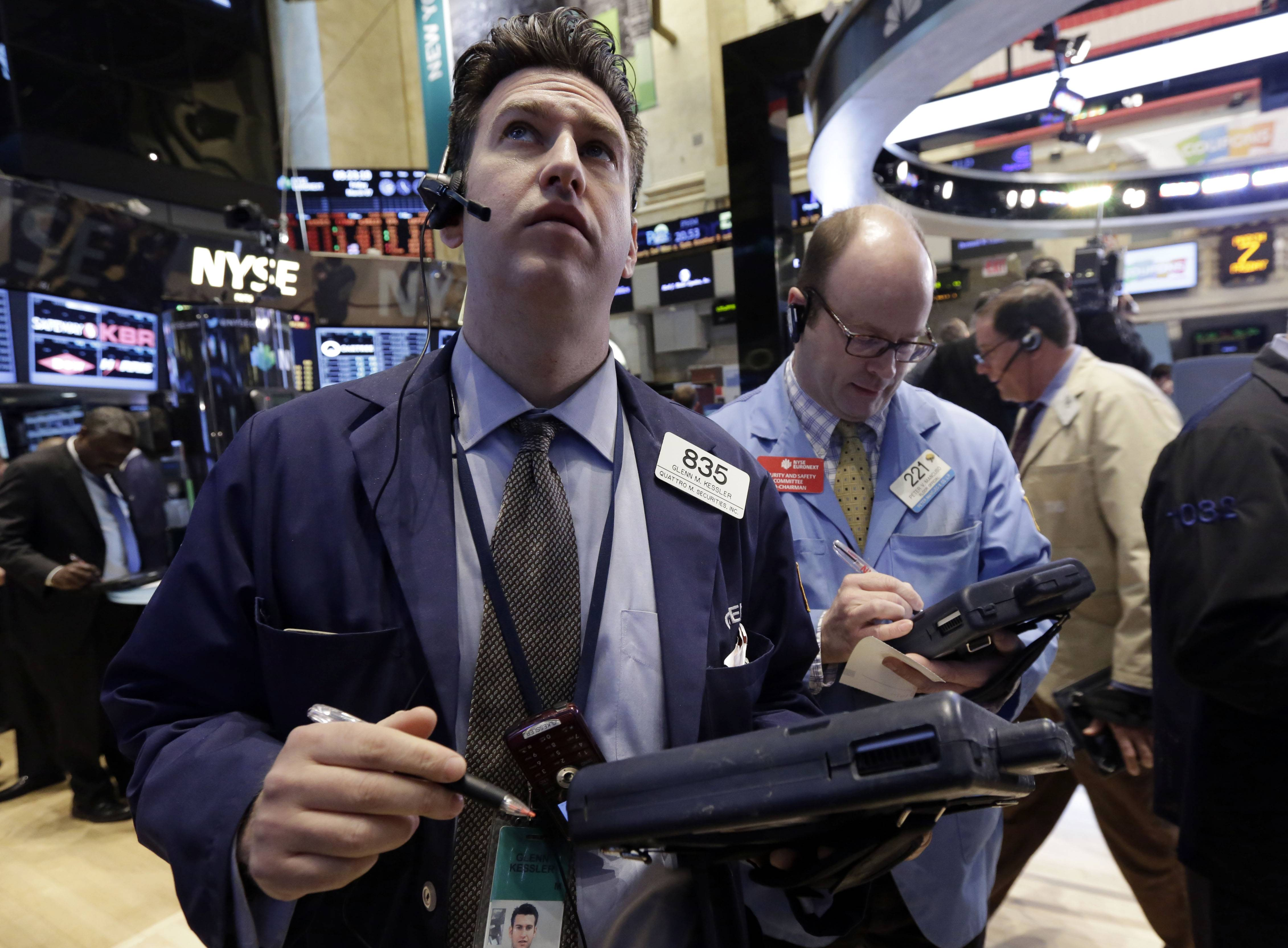 Stocks fell Tuesday, after the Standard & Poor's 500 Index climbed to a record last week, as commodity shares slumped with copper and oil prices amid concern over China's economy.