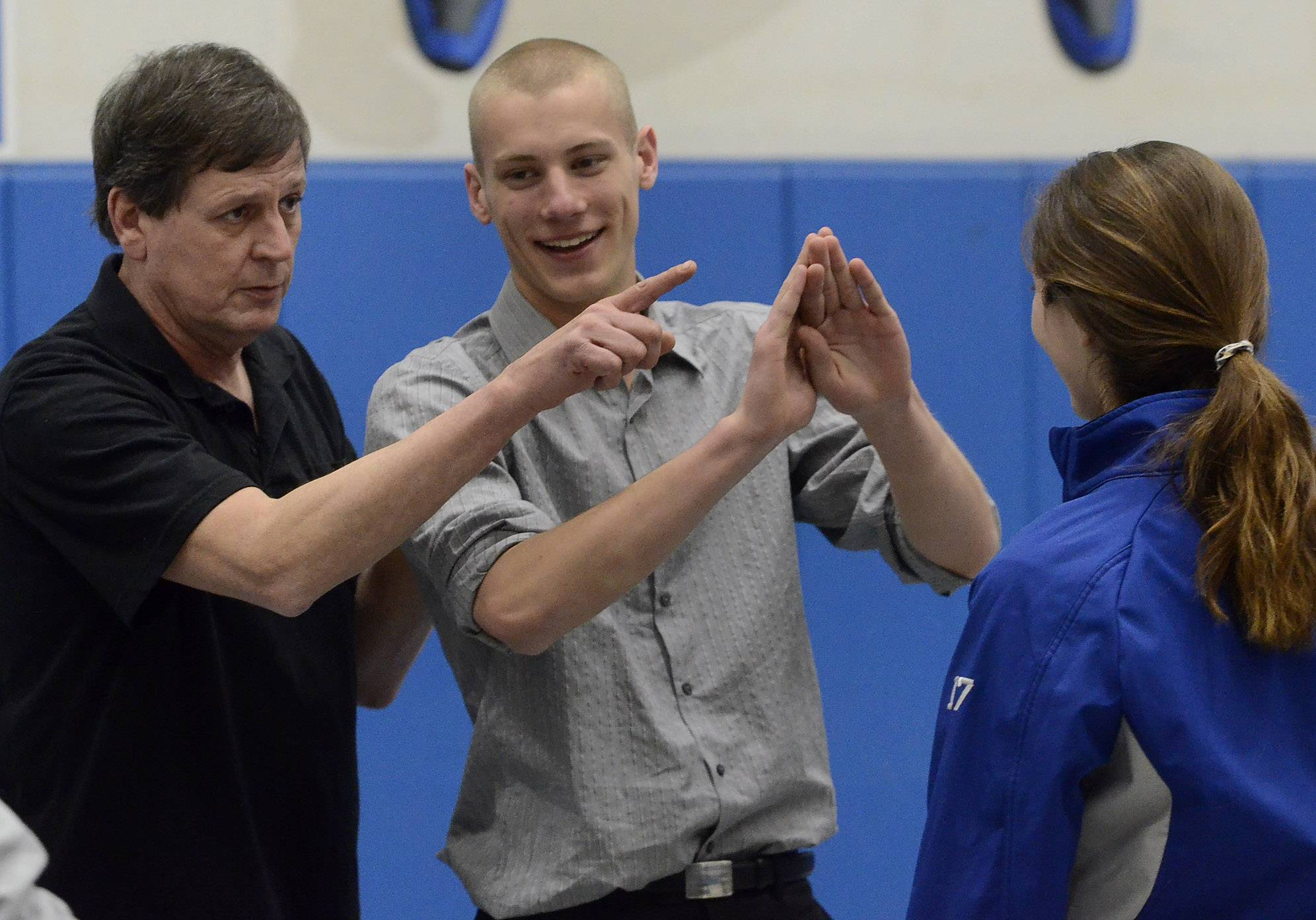 Self-defense expert Michael Theriault of The Brave Way LLC in Mundelein, teaches Vernon Hills High School students Kyle Whitney and Mallory Rose self-defense tactics.