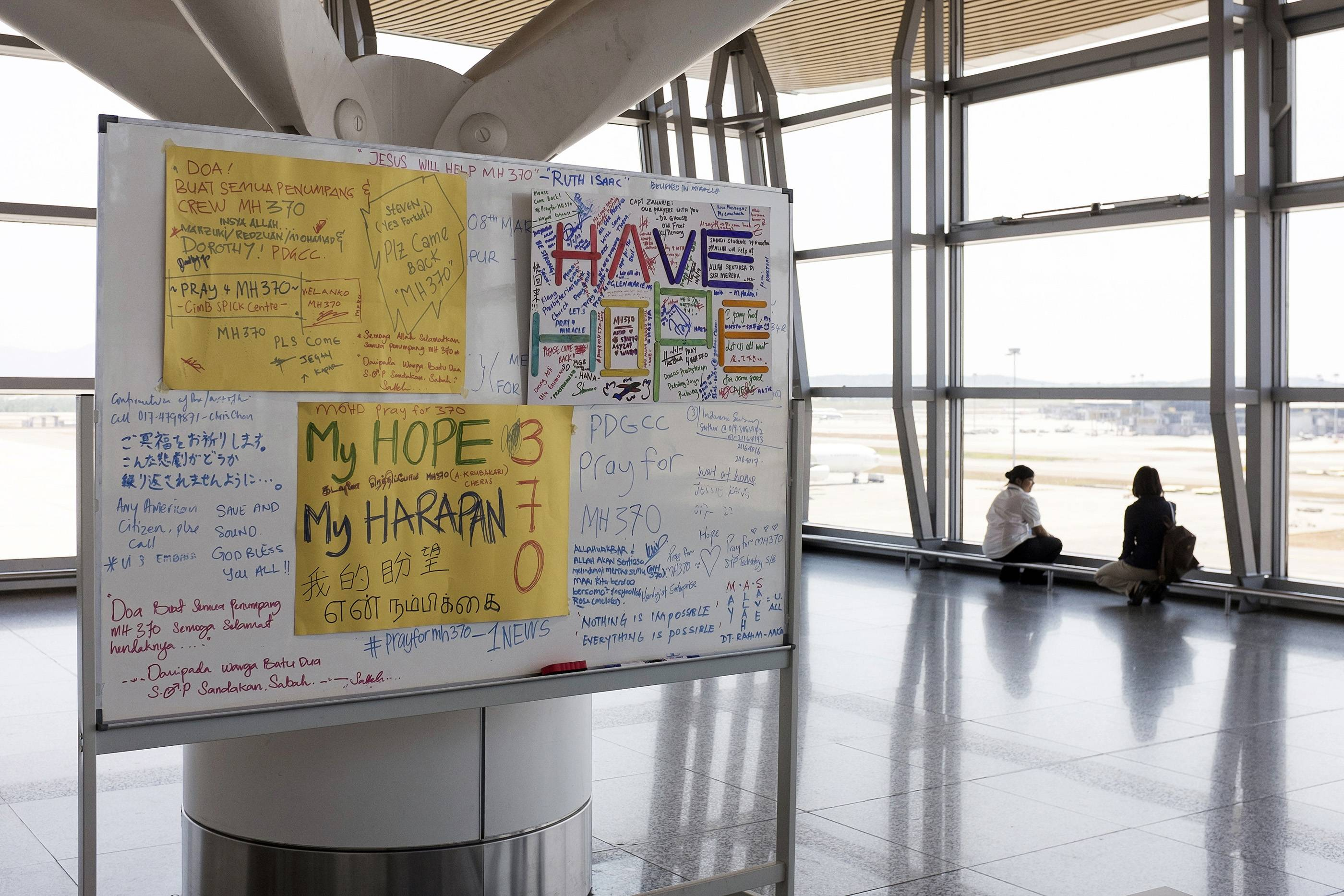 A board with messages for the passengers of missing the Malaysian Airlines Flight 370 stands at Kuala Lumpur International Airport in Sepang, Malaysia, Tuesday.