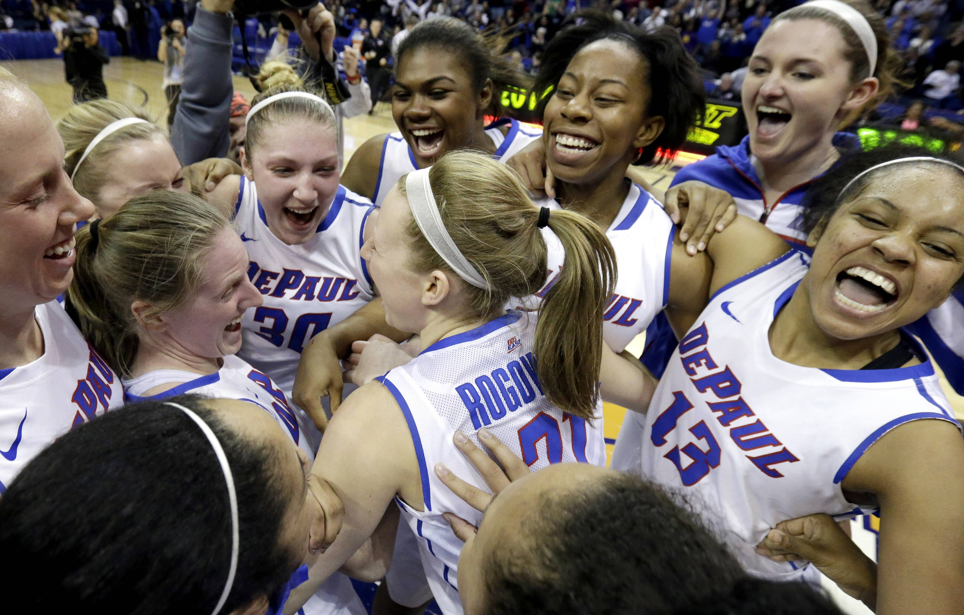 DePaul players celebrate after they defeated St. John's 65-57 during an NCAA college basketball game in the final of the 2014 Big East women's basketball tournament in Rosemont, Ill., Tuesday, March 11, 2014. (AP Photo/Nam Y. Huh)