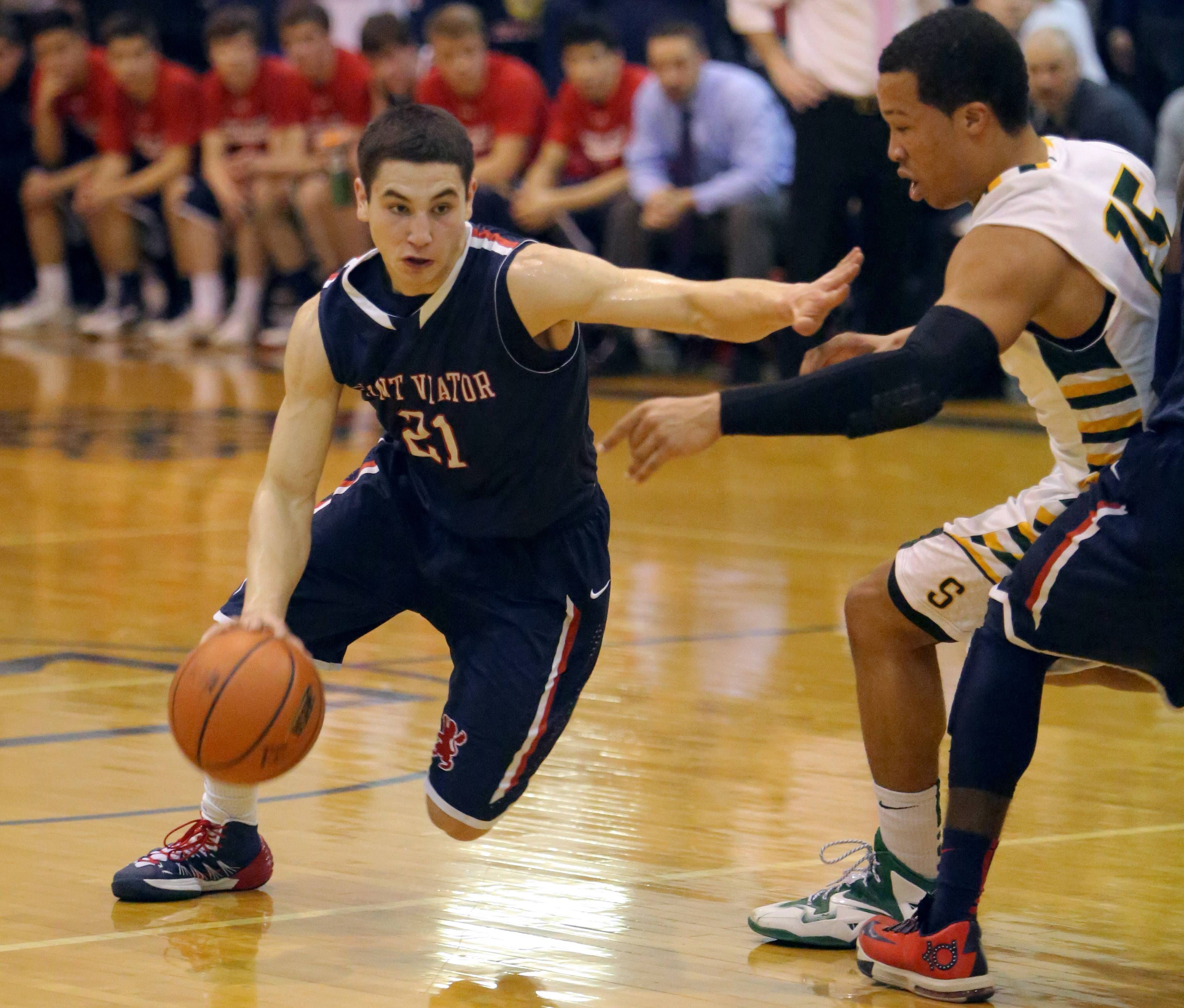 St. Viator's Mark Falotico, left, drives on Stevenson's Jalen Brunson.