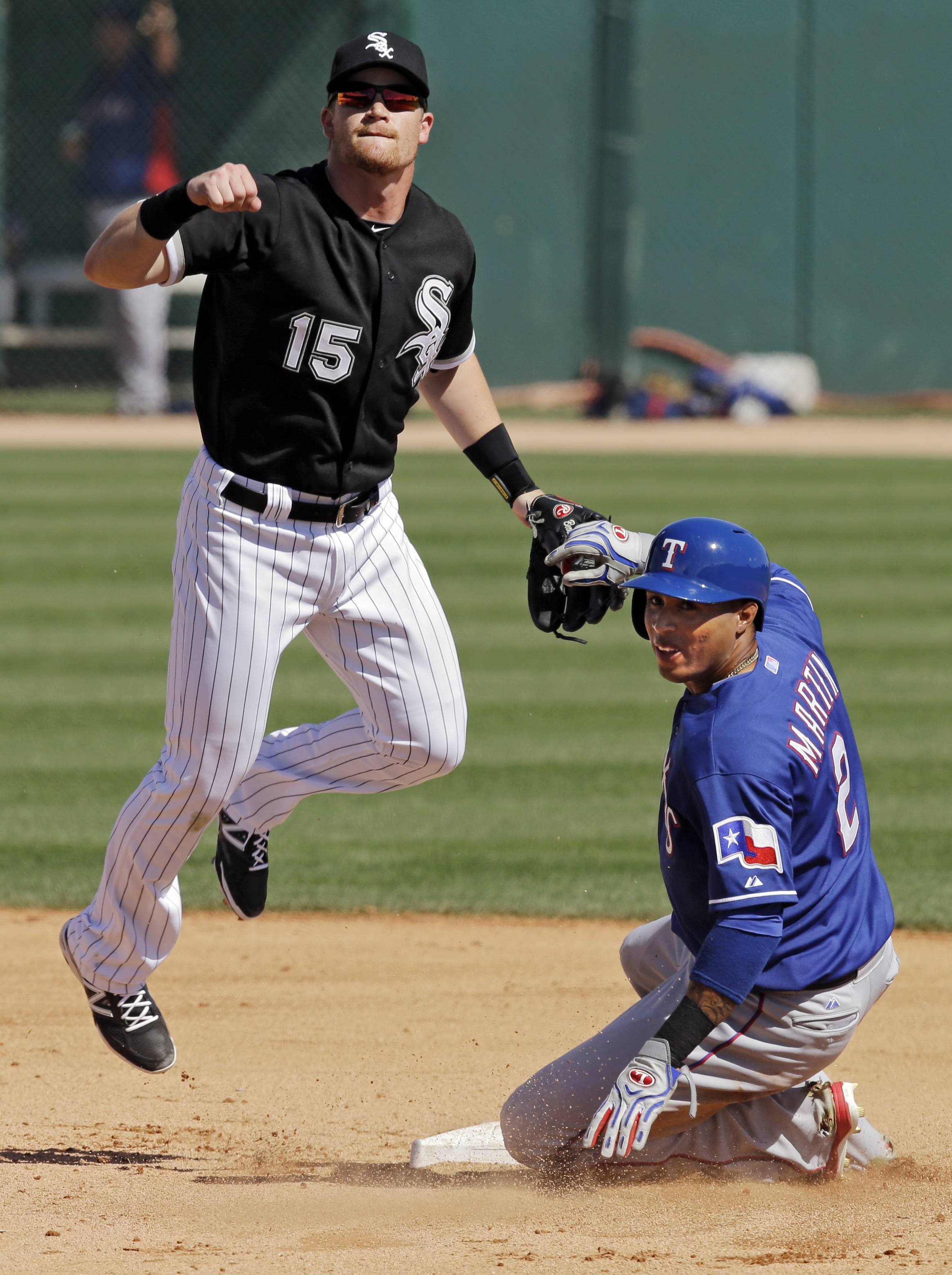 Chicago White Sox second baseman Gordon Beckham (15) watches his throw to first after forcing out Texas Rangers' Leonys Martin to start a double play in the fifth inning of a spring exhibition baseball game Tuesday, March 11, 2014, in Glendale, Ariz. (AP Photo/Mark Duncan)