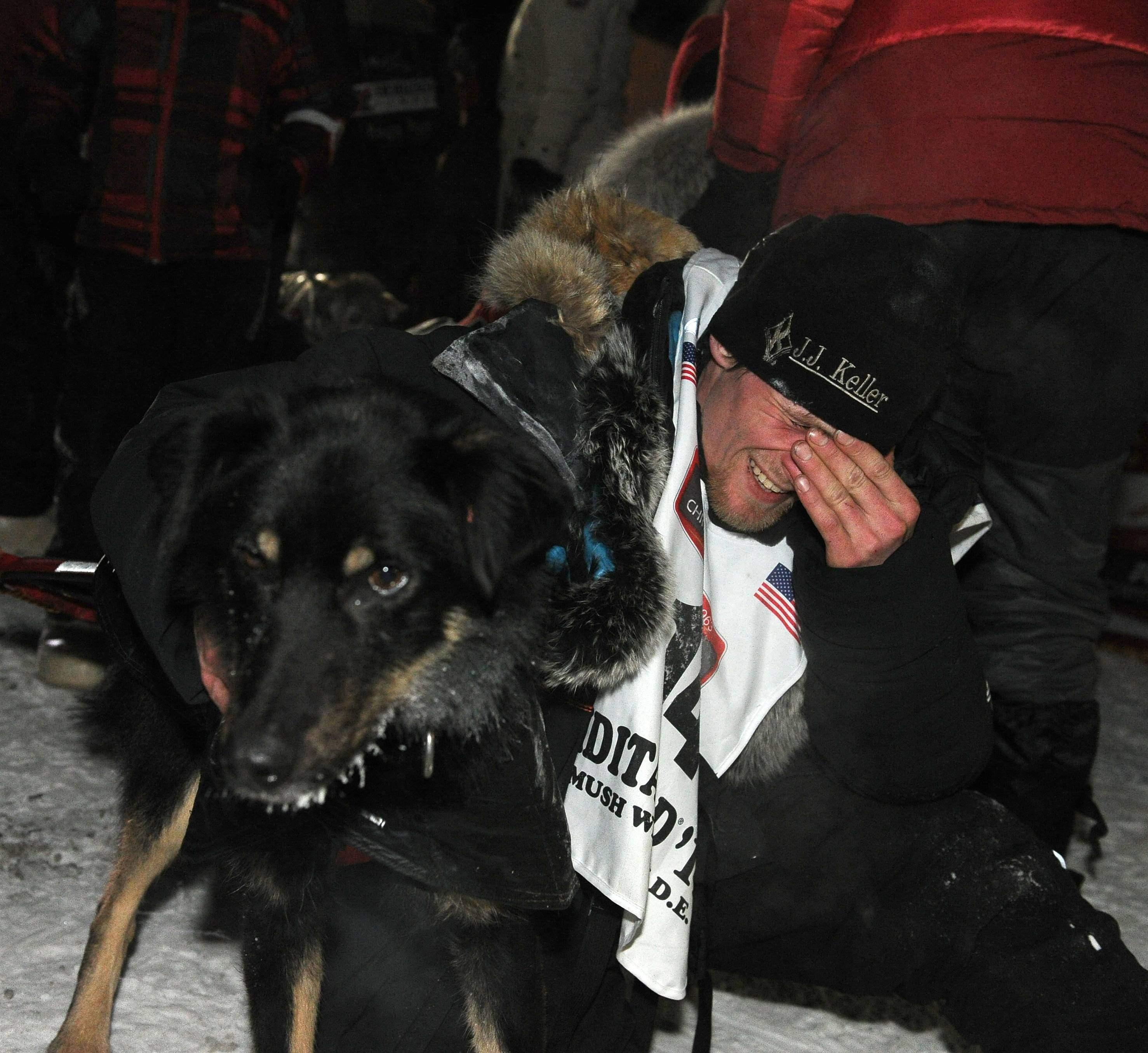 Dallas Seavey holds his lead dog Beatle after winning the 2014 Iditarod Trail Sled Dog Race in Nome, Alaska, Tuesday, March 11, 2014.