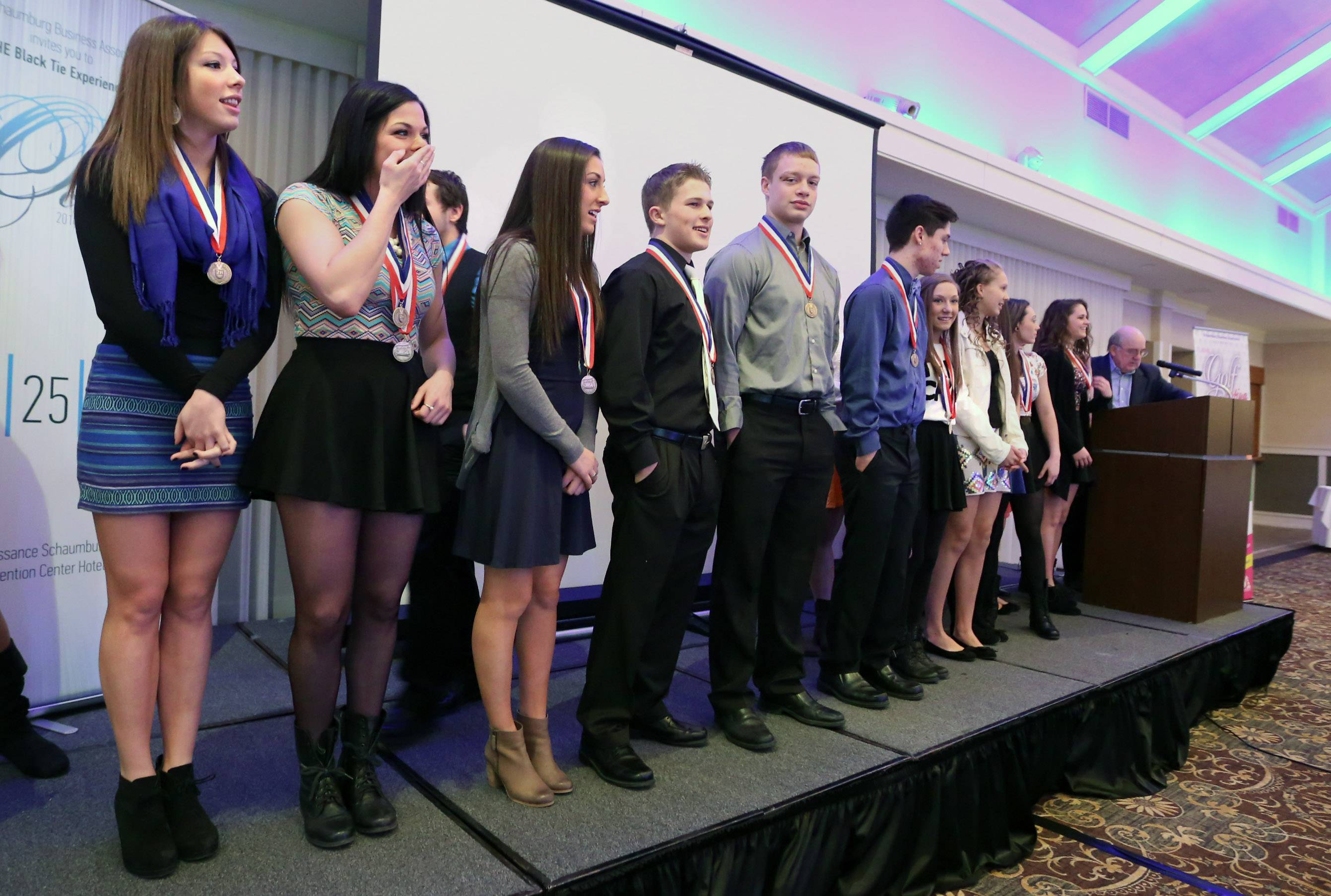 The 2014 state championship coed cheerleading squad from Conant High School was honored Tuesday by the Schaumburg Business Association during its monthly breakfast meeting.
