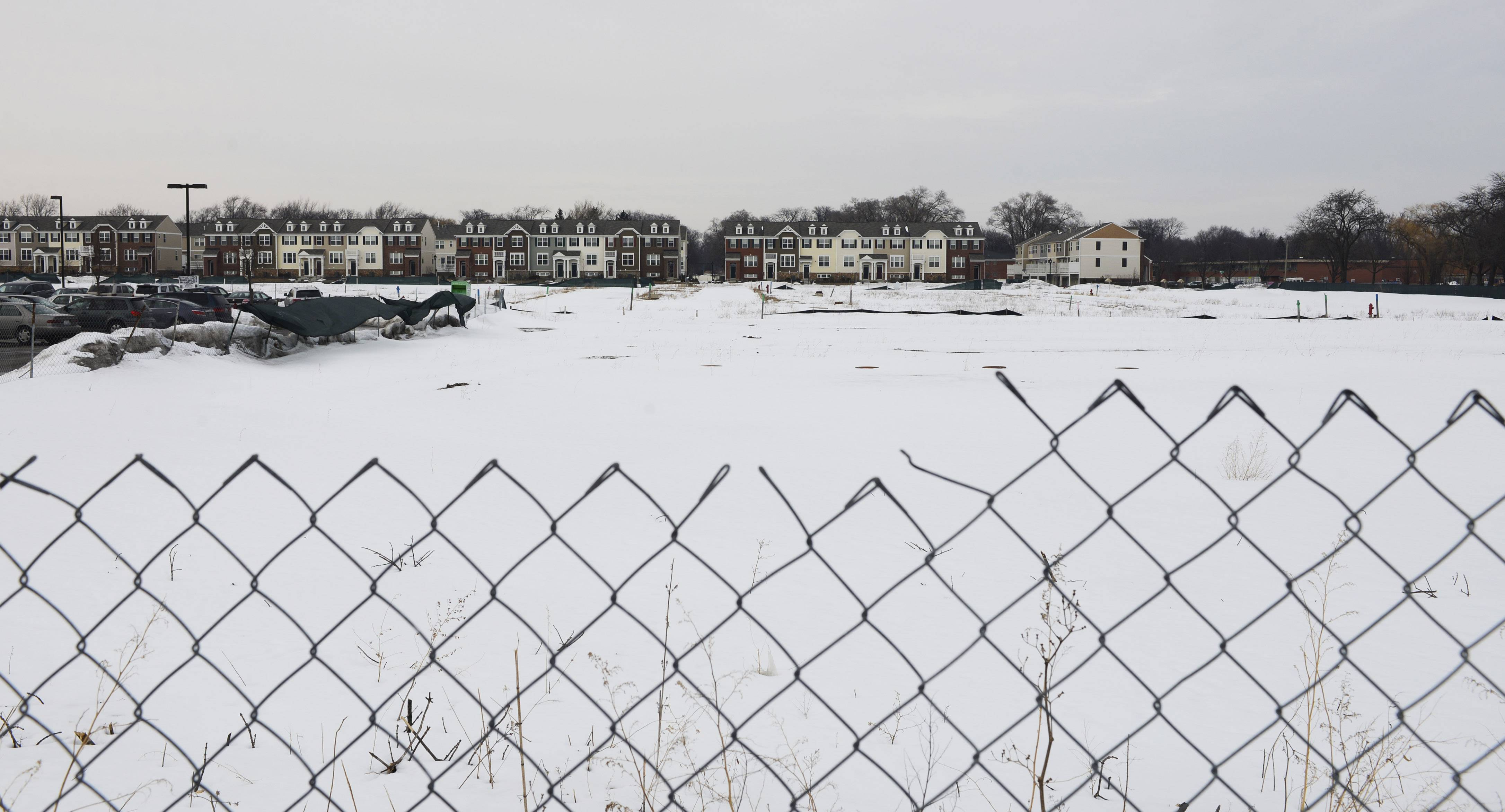 Developers are awaiting Arlington Heights village board approval to move forward with long-delayed plans to build single-family homes on the Arlington Market site near Dryden Place and Kensington Road.