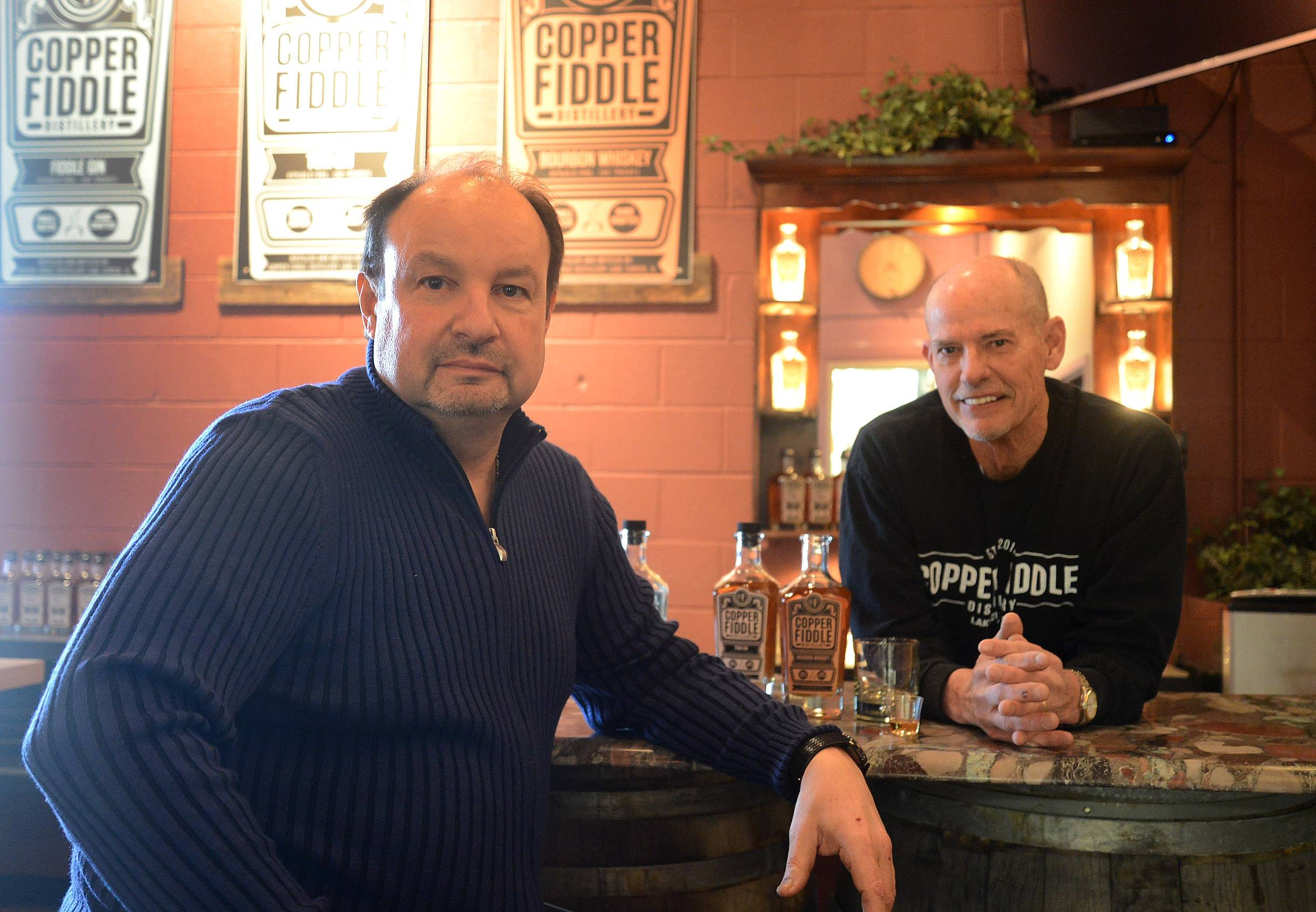 Jose Hernandez, left, and Fred Robinson of Copper Fiddle Distillery in Lake Zurich produce small-batch bourbon and gin in their artisan business.