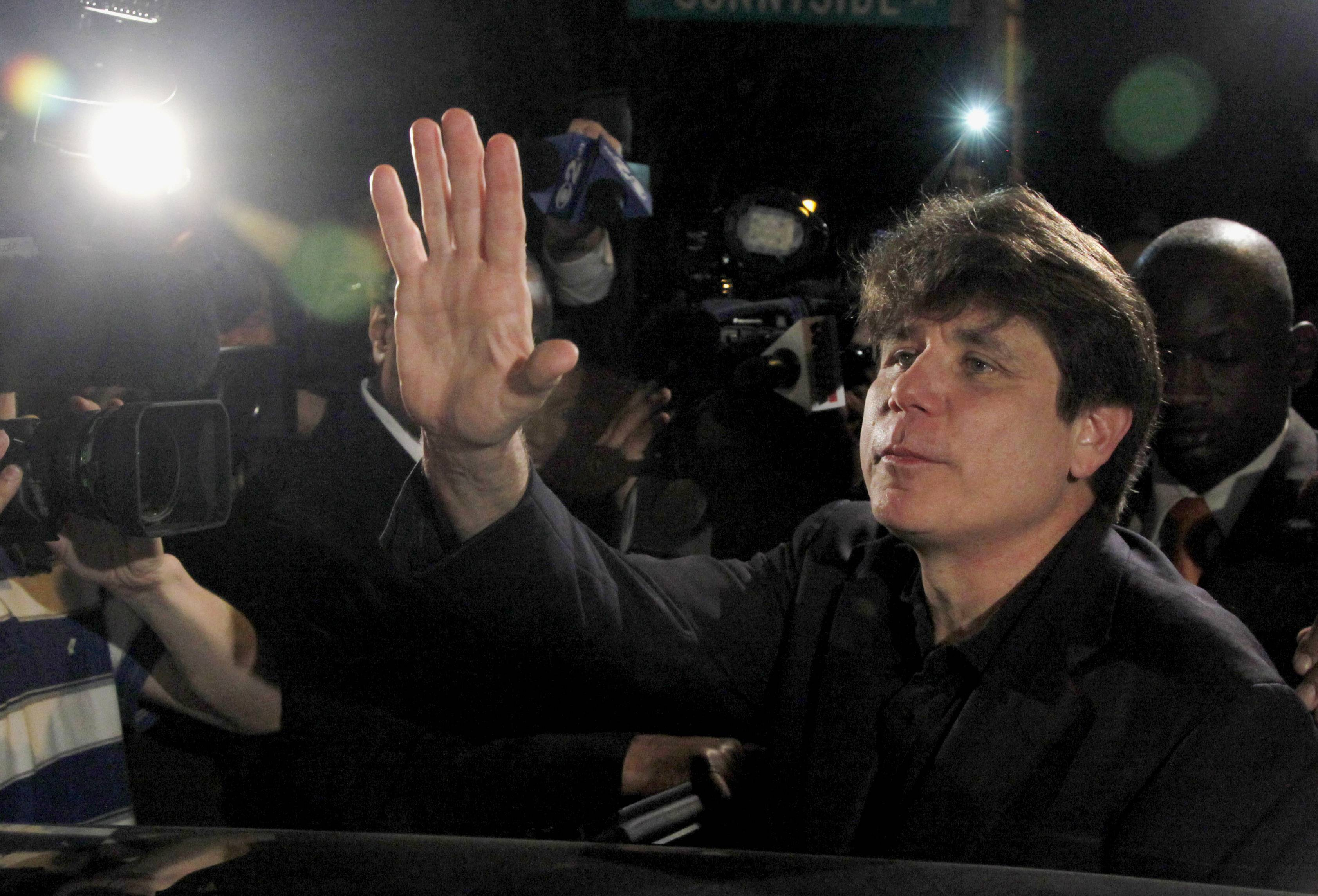 Former Illinois Gov. Rod Blagojevich waves as he departs his Chicago home March 15, 2012, for Littleton, Colo., to begin his 14-year prison sentence on corruption charges. On Tuesday, the 7th U.S. Court of Appeals in Chicago said transcripts of FBI wiretaps not played at Blagojevich's corruption trials will remain sealed. The court is still mulling its decision on the imprisoned former Illinois governor's request to toss his convictions.