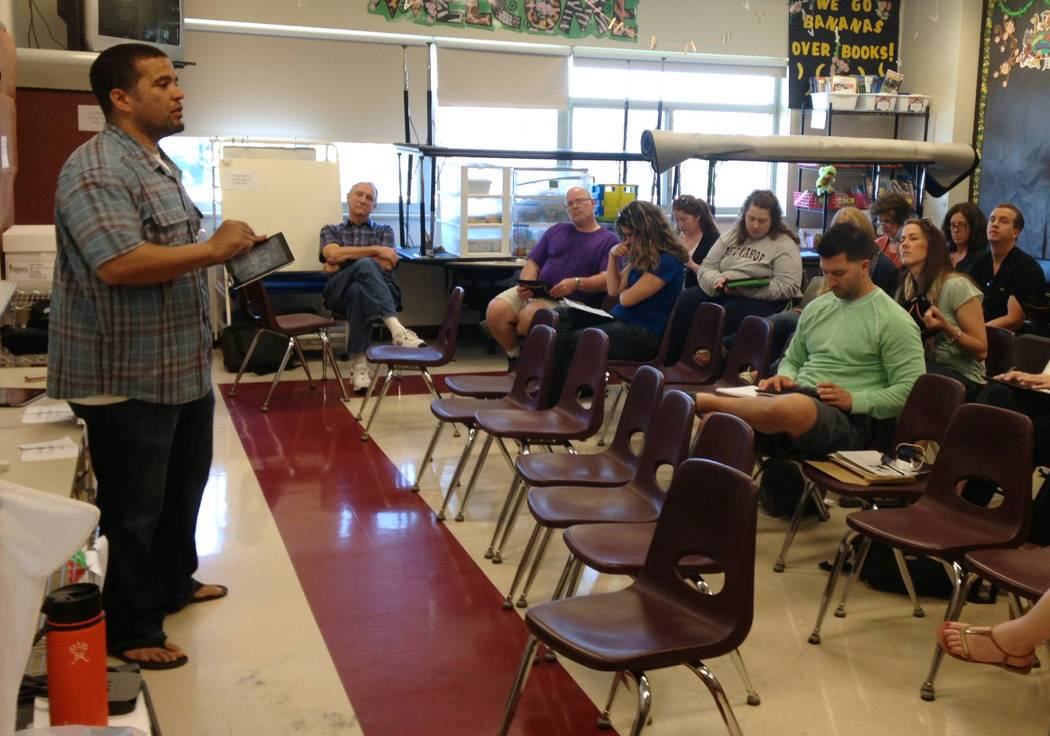 Teachers in Hawthorn District 73 in technology training last summer. The district equipped 180 teachers with iPads this school year as part of a multiyear technology program.
