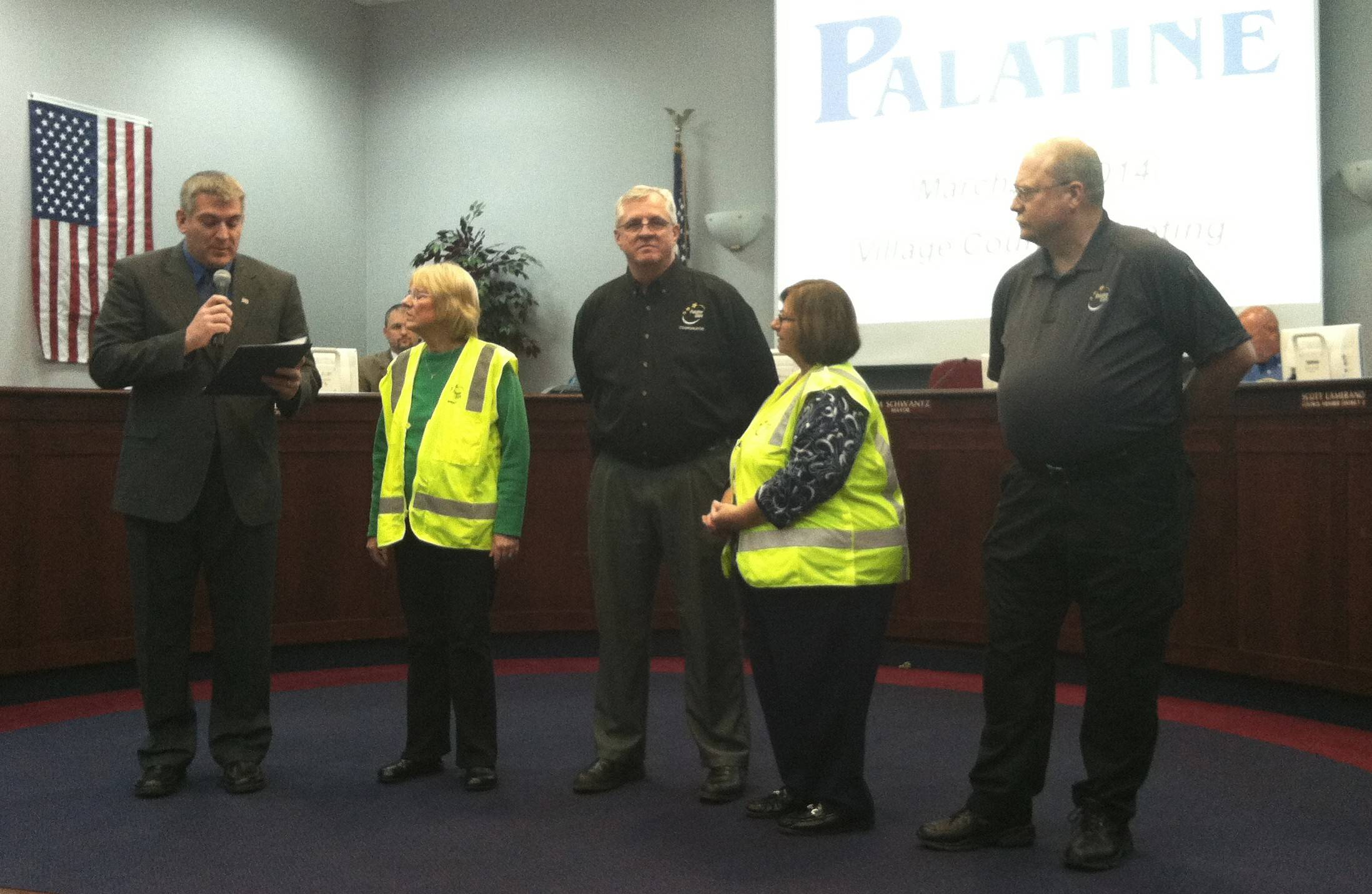 Palatine Mayor Jim Schwantz, left, reads from a proclamation honoring members of the Palatine Emergency Management Agency including, from left to right, Cindy Wolta, Tom Smith, Linda Trilling and Bob Worthy. Smith is retiring after nine years as the group's coordinator.