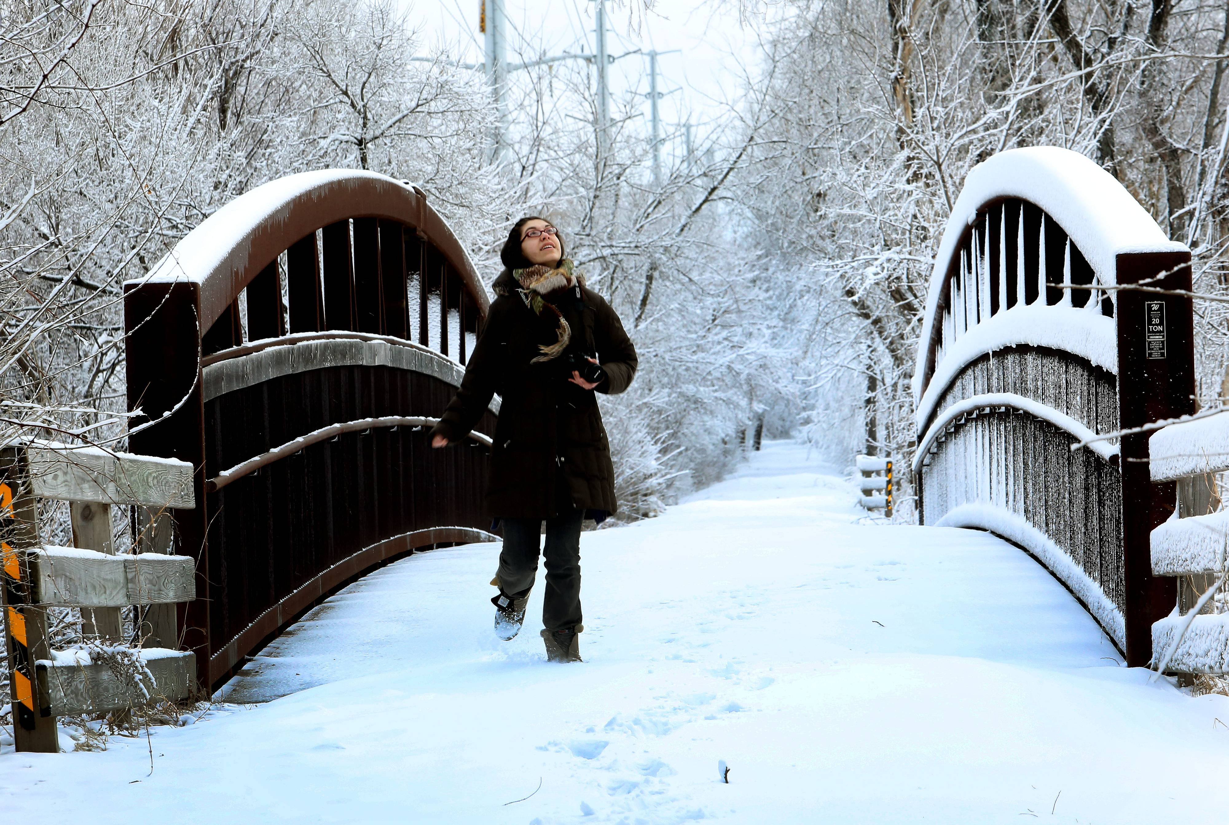 "Wheaton Warrenville South senior Hannah Burns takes advantage of a late school start to get a few photos of the snow on the Prairie Path in Warrenville on Wednesday. Although she wasn't looking forward to another snowfall, ""I love it. It's beautiful"", she said."