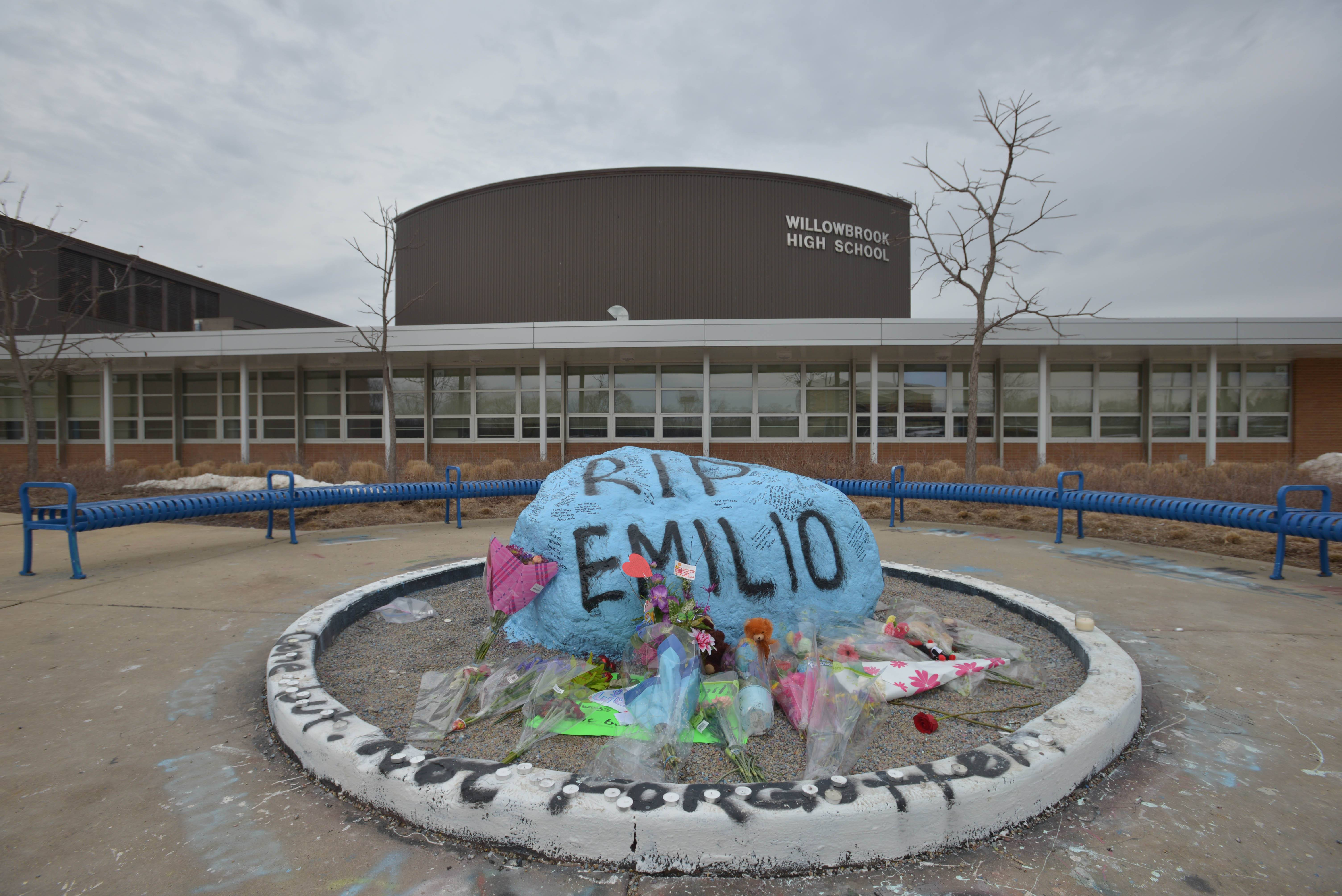 Classmates of Emilio Perez decorated a rock outside Willowbrook High School and held a memorial service Monday in honor of the 17-year-old. Perez was struck and killed Saturday in a hit-and-run on I-88, near Joslin, Ill.