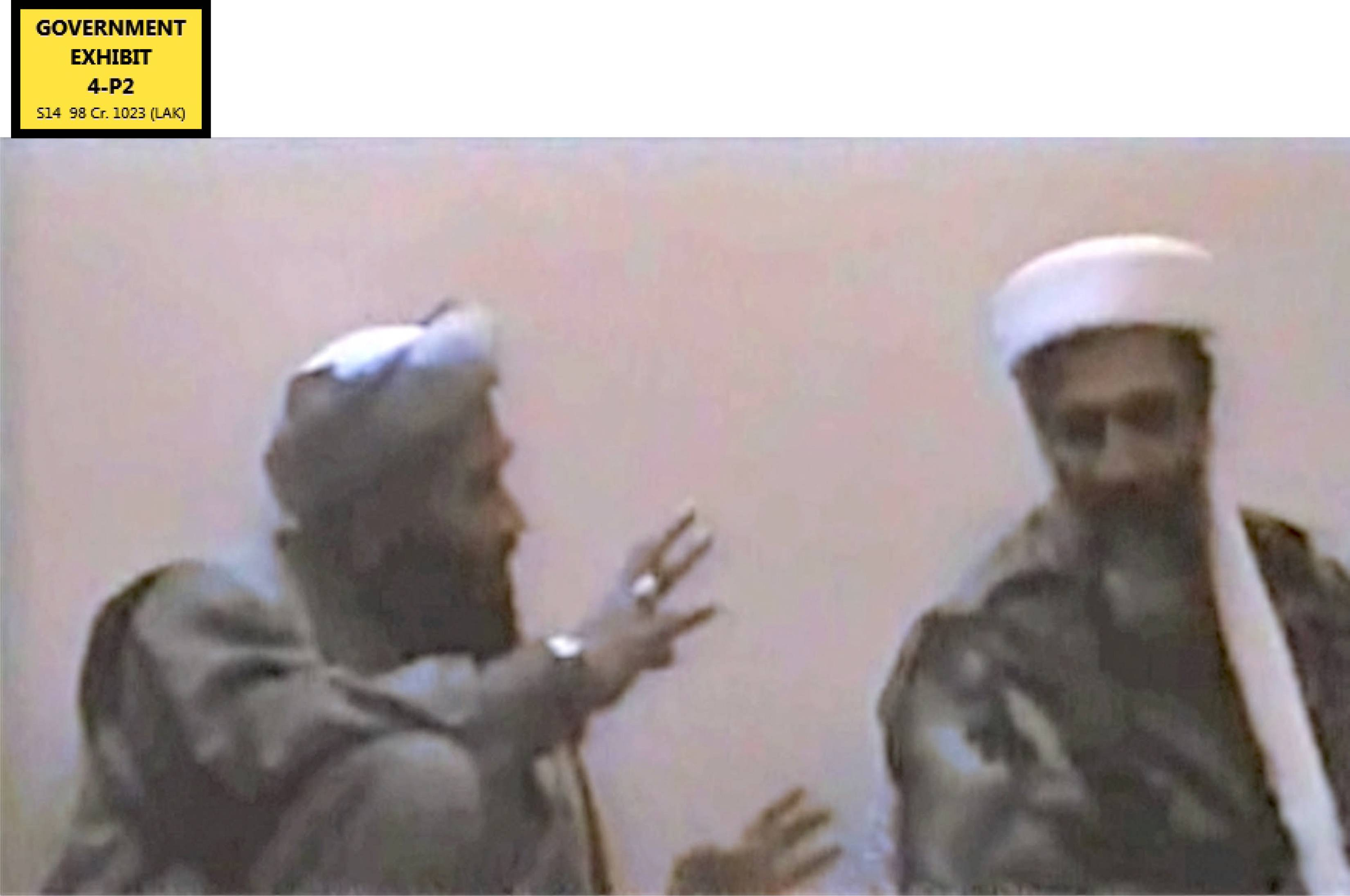 In this undated Photo provided by the United States Attorney's Office for the Southern District of New York, defendant Suliman Abu Ghayth, left, gestures toward al-Qaida founder Osama bin Laden, in a room somewhere in Afghanistan. Abu Ghayth, Bin Laden's son-in-law, is being tried in New York for plotting to kill Americans by being a motivational speaker at al-Qaida training camps before the Sept. 11 attacks.