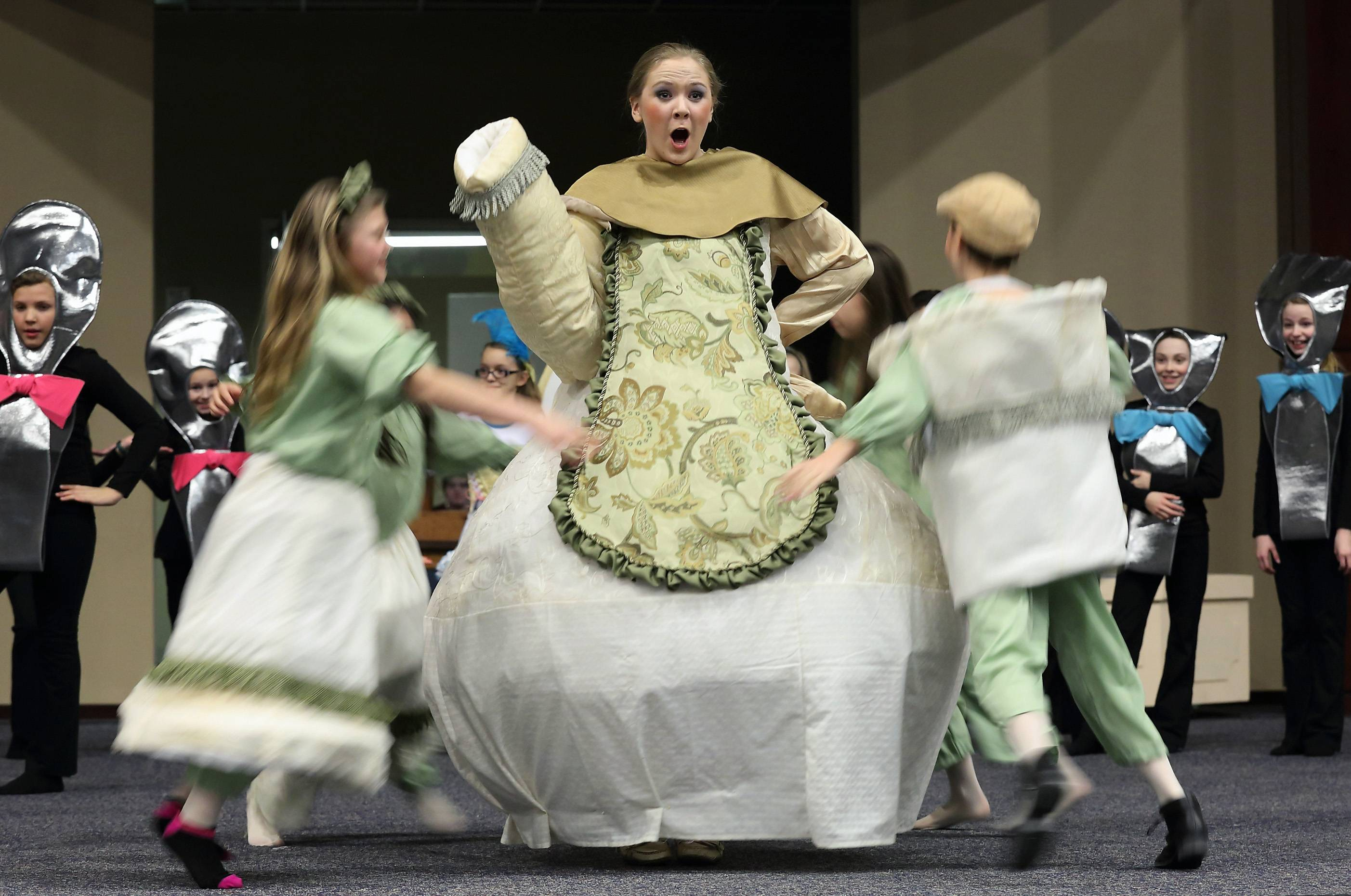 "Kate Dolan is Mrs. Potts in the production of ""Beauty and the Beast"" opening Thursday at Harvest Christian Academy in Elgin."
