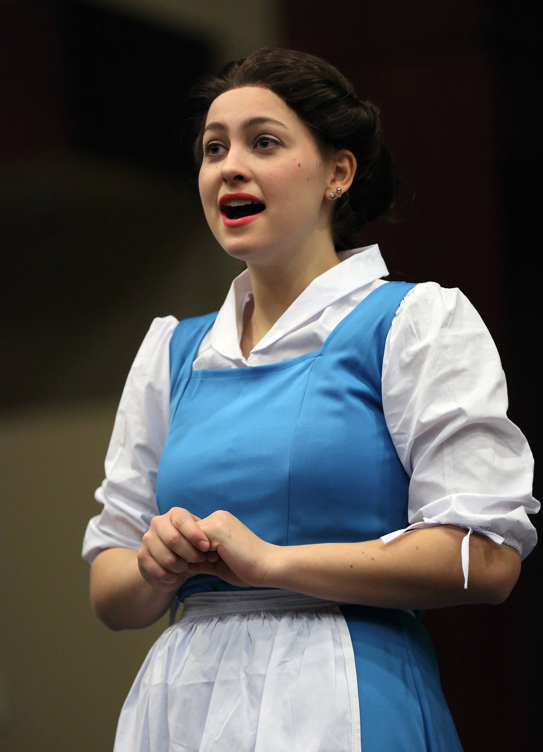 "Olivia Thiel is Belle in the production of ""Beauty and the Beast"" Thursday through Saturday at Harvest Christian Academy in Elgin."