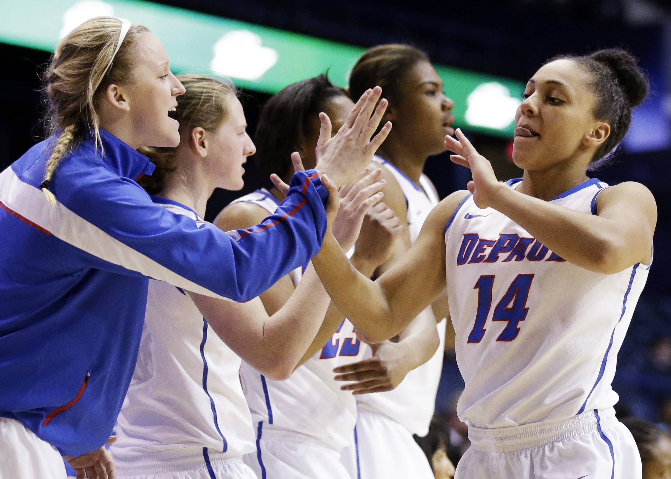 DePaul guard Jessica January (14) celebrates with teammates as she walks back to the bench during the second half of an NCAA college basketball game against St. John's in the final of the 2014 Big East women's basketball tournament in Rosemont, Ill., Tuesday, March 11, 2014. DePaul won 65-57.