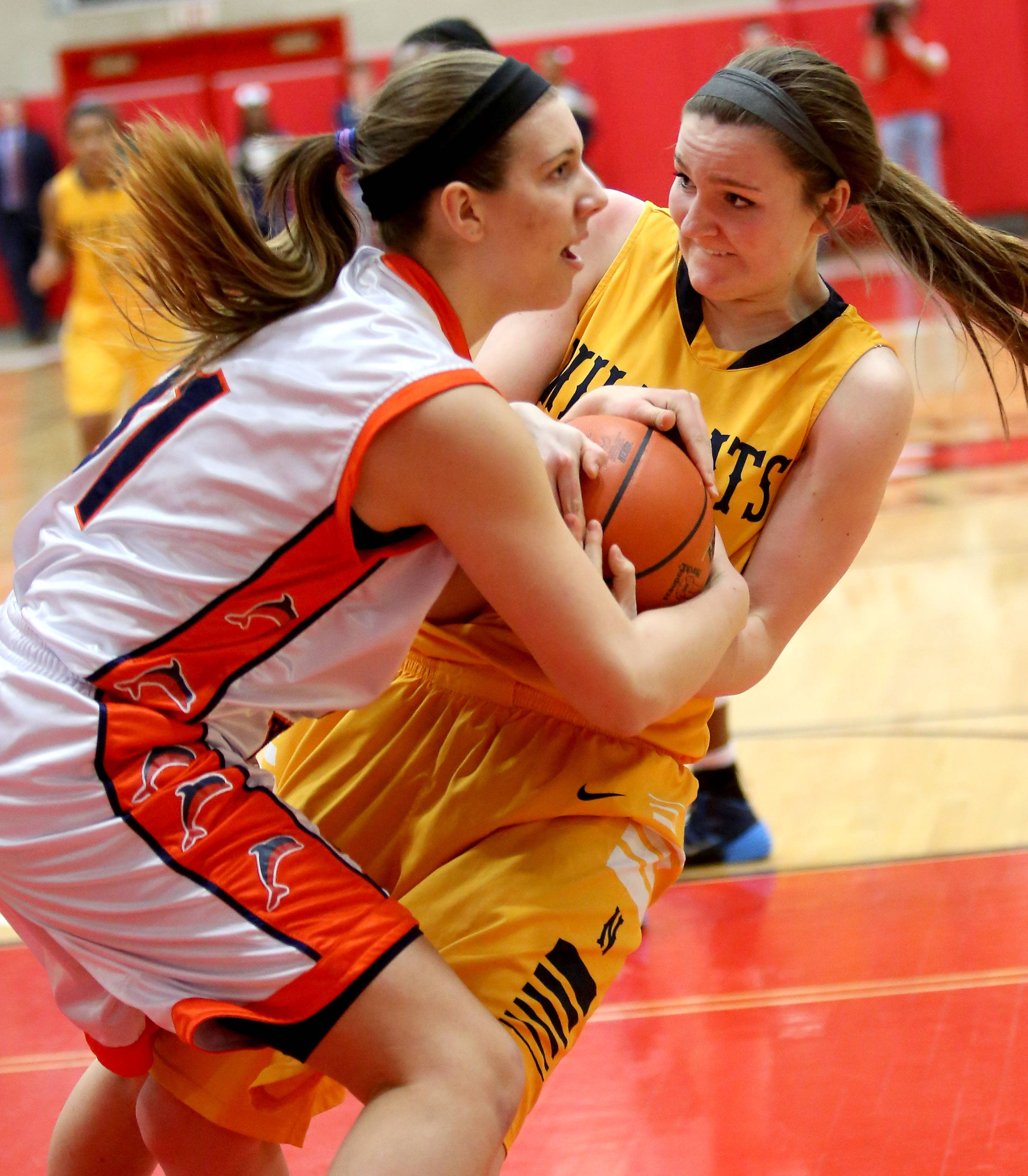 Neuqua Valley's Jamie McInereney, right, fights for the ball with Whitney Young's Isabelle Spingola during Monday's Class 4A supersectional girls basketball game at Hinsdale Central.