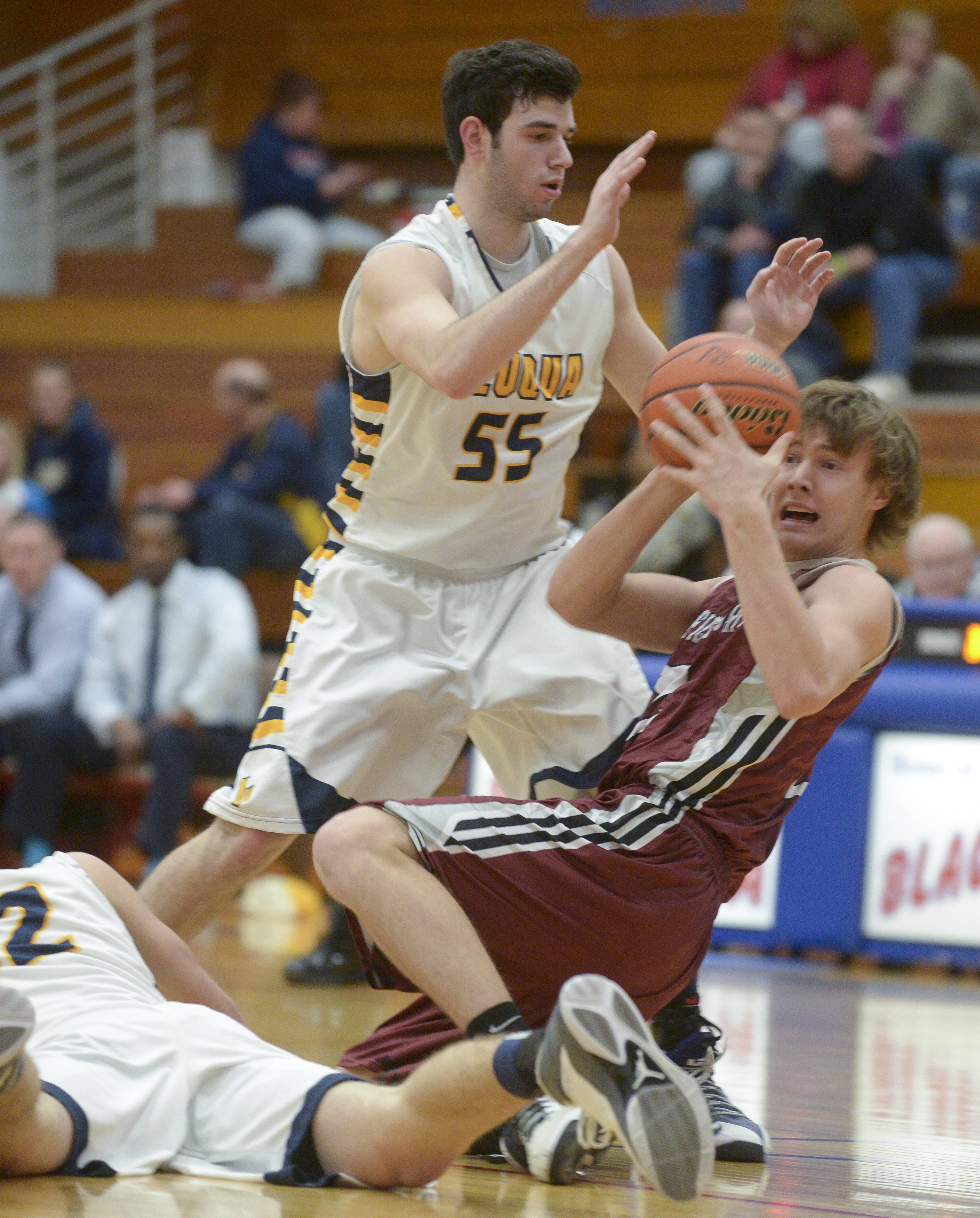 Neuqua Valley's Zach Incaudo looks on as Plainfield North's Kyle Speas takes a tumble during Wednesday's Class 4A West Aurora regional semifinal game.