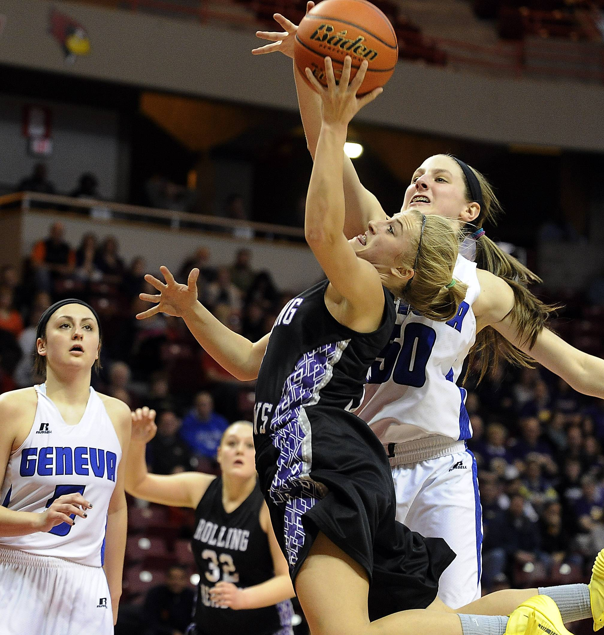 Rolling Meadows' Jackie Kemph delivers to the basket but is blocked by Geneva's Grace Loberg during Friday's Class 4A semifinal game in Normal.