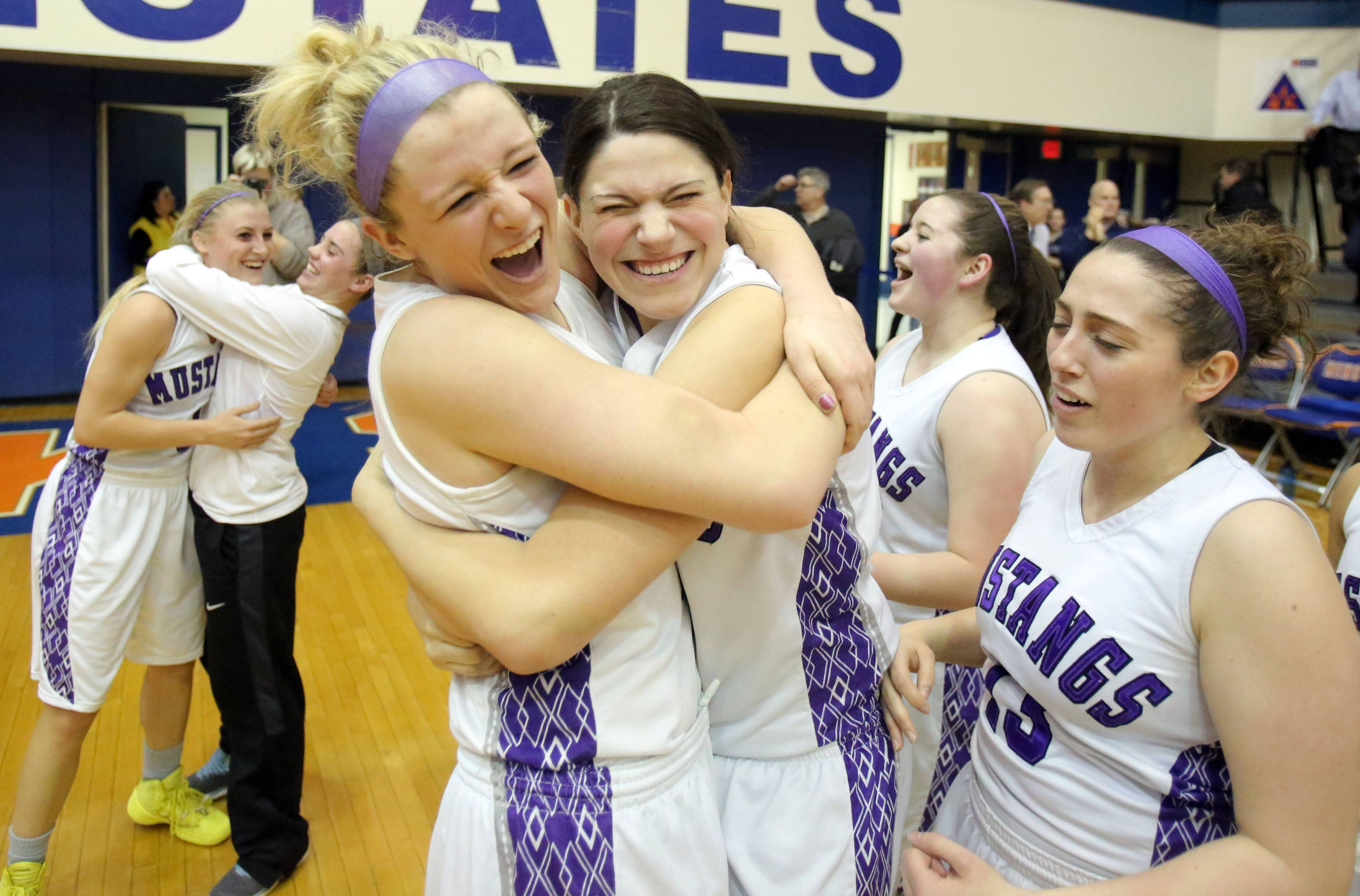 Rolling Meadows players celebrate their win over New Trier at Monday's Class 4A supersectional game at Hoffman Estates High School.