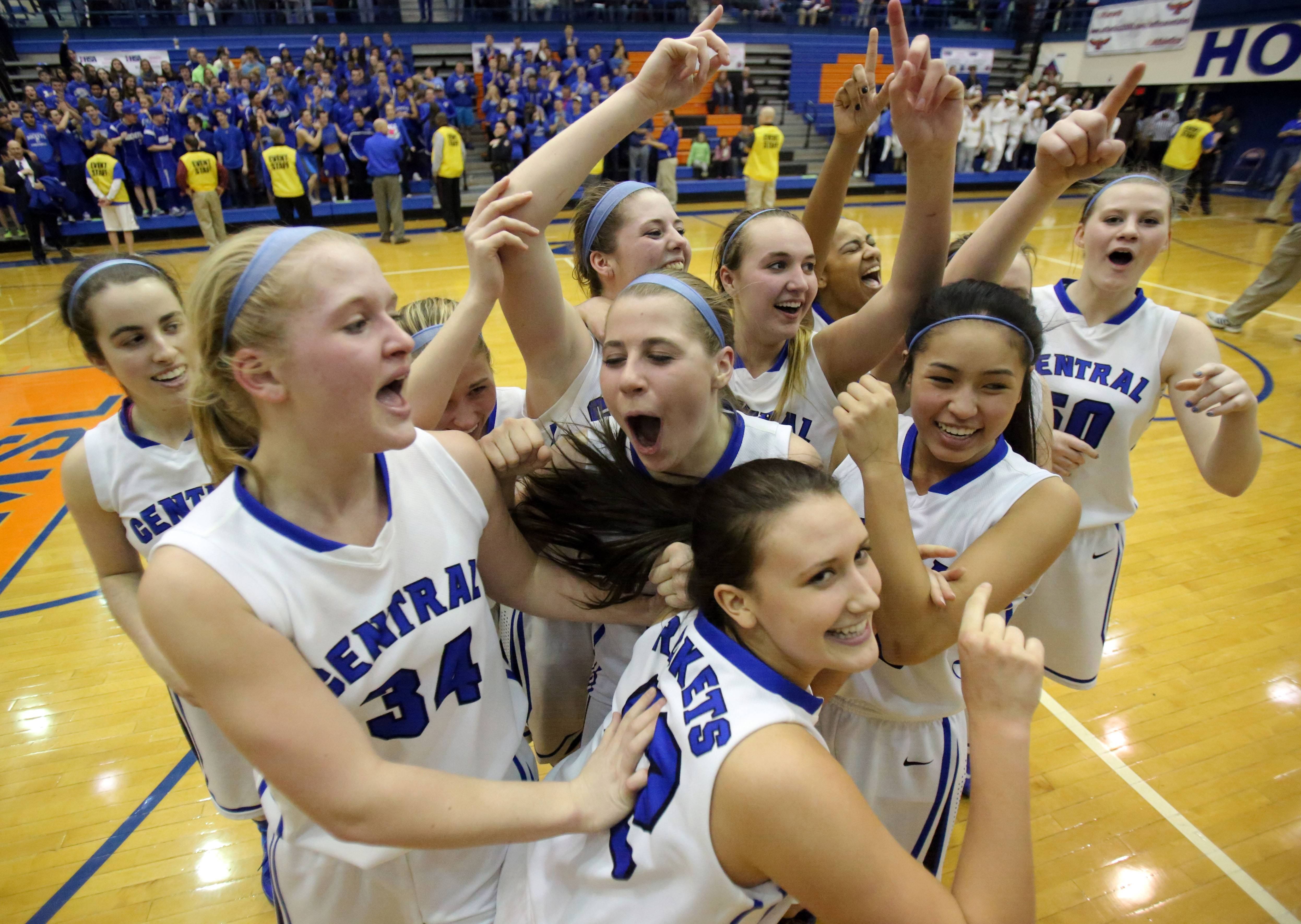 Burlington Central players go crazy after defeating Carmel 41-29 in Monday's Class 3A supersectional girls basketball game in Hoffman Estates.