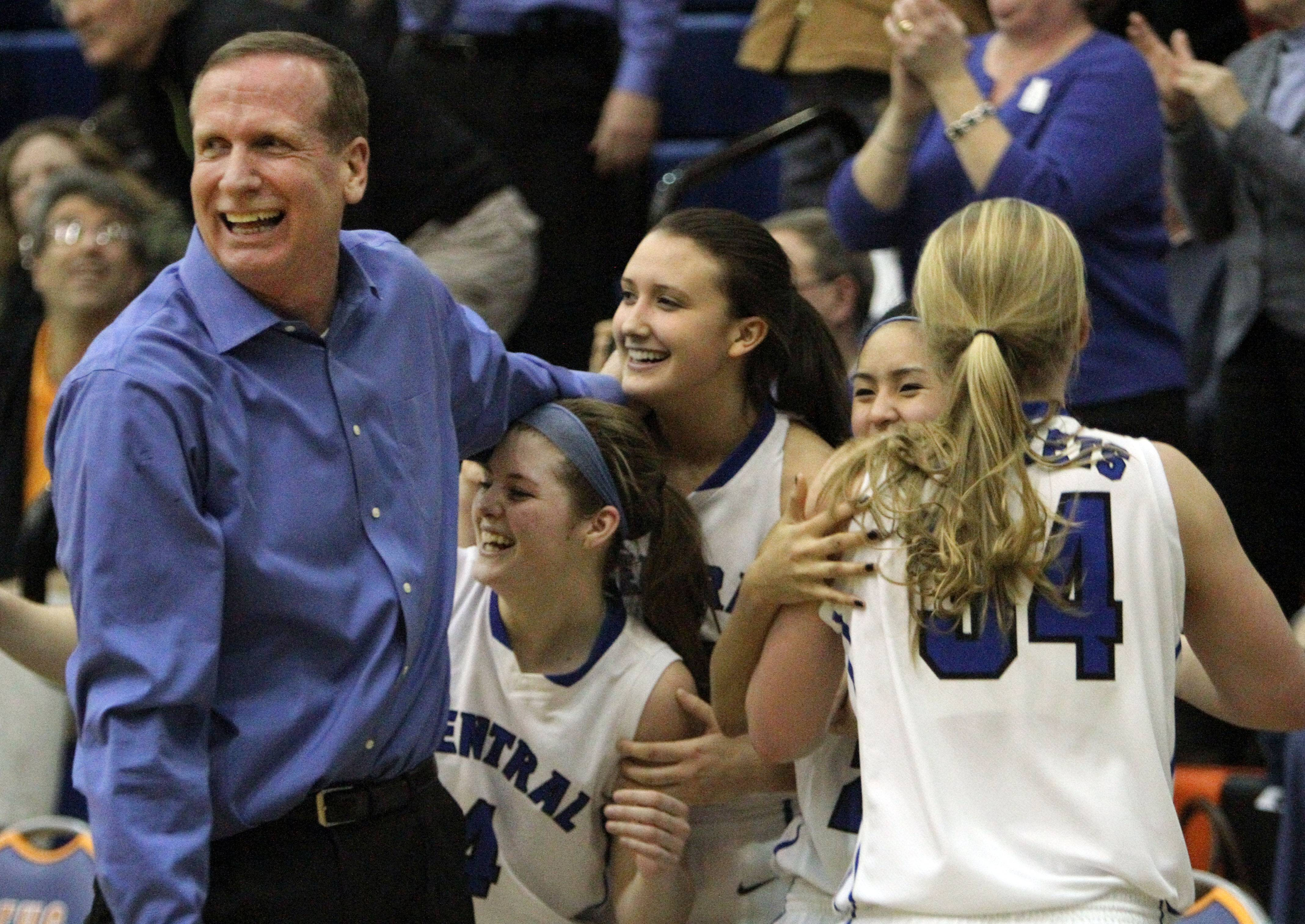 Burlington Central head coach Mark Smith celebrates with his players after defeating Carmel Monday.