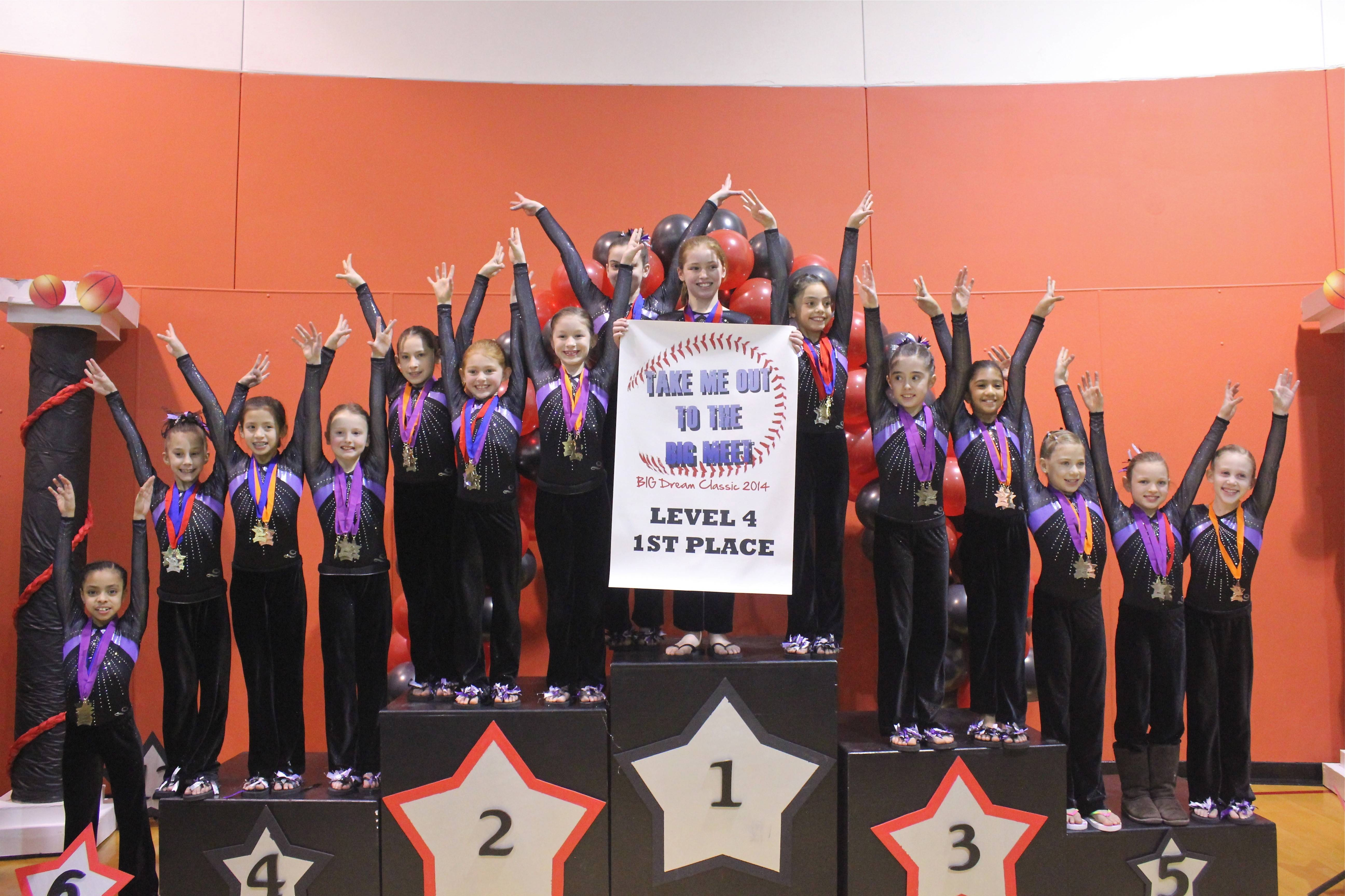The Level 4 girls from Ultimate Gymnastics of Gurnee celebrate after a strong performance at the recent Big Dreams Classic in Burr Ridge. It was the fourth time the girls have taken the team title at a competitive meet this season.
