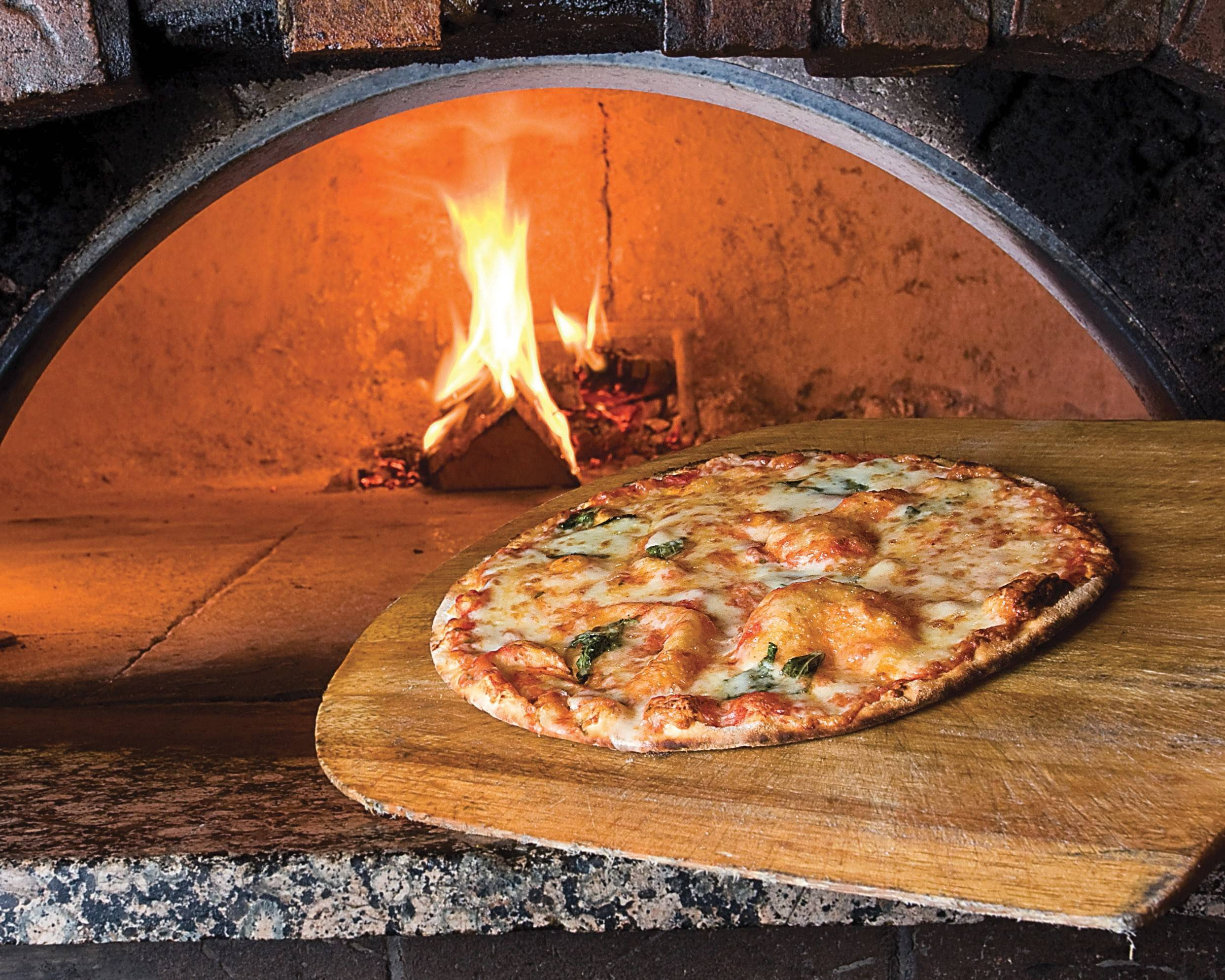 Tuscany celebrates Pi Day with $3.14 pizzas, like this Margherita version, available for lunch.